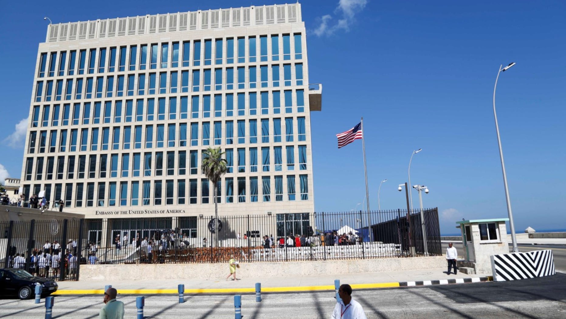 In this photo taken Aug. 14, 2015, a U.S. flag flies at the U.S. embassy in Havana, Cuba. Two more American diplomats who served in Cuba are affected by health attacks in Cuba, raising the total to 21.