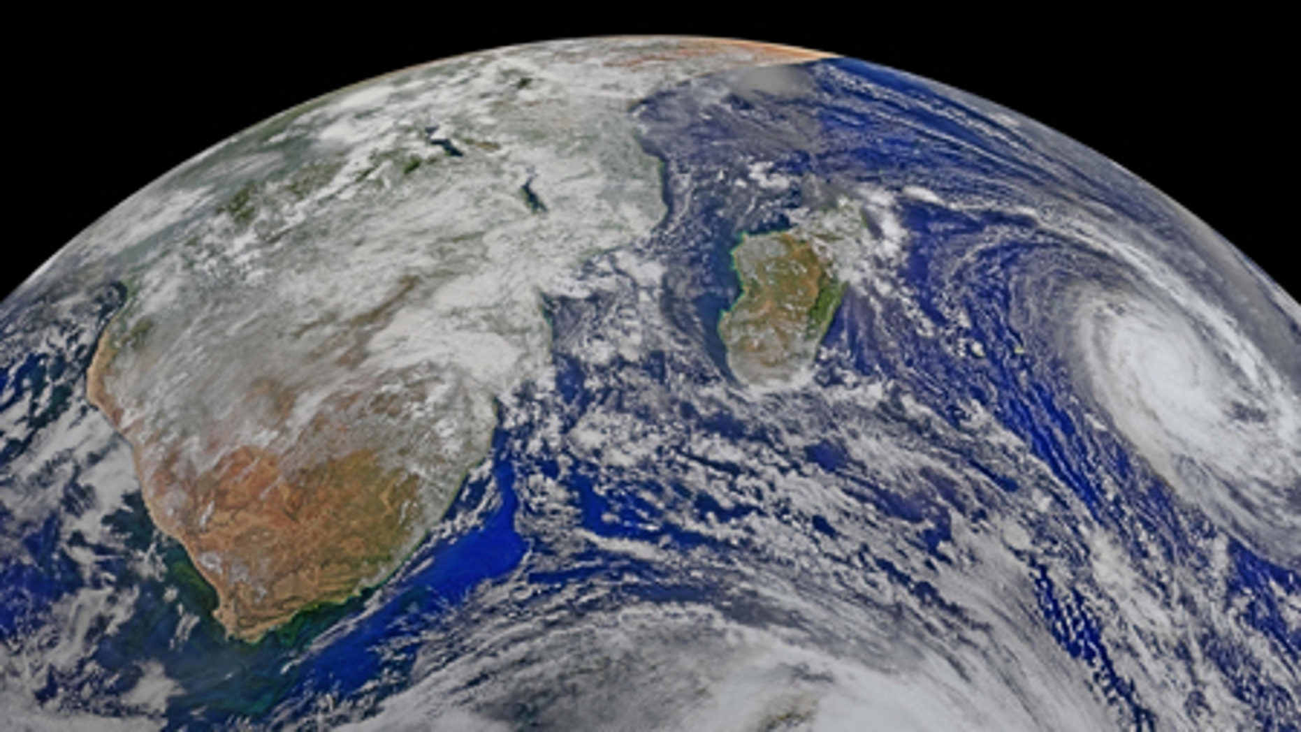 April 9, 2015: This image provided by NASA Data from six orbits of the Suomi-NPP spacecraft on have been assembled into this perspective composite of southern Africa and the surrounding oceans. Tropical Cyclone Joalane is seen over the Indian Ocean. The image was created by the Ocean Biology Processing Group at NASA's Goddard Space Flight Center in Greenbelt, Maryland.
