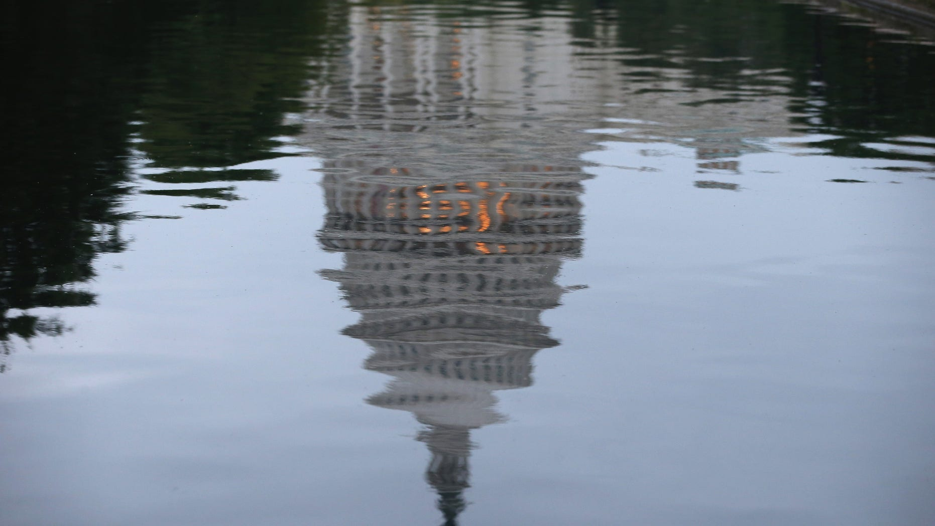 WASHINGTON, DC - JUNE 11:  The U.S. Capitol is reflected in water on the morning of June 11, 2014 in Washington, DC. Yesterday House Majority Leader Eric Cantor (R-VA) lost his Virginia primary to Tea Party challenger Dave Brat.  (Photo by Mark Wilson/Getty Images)