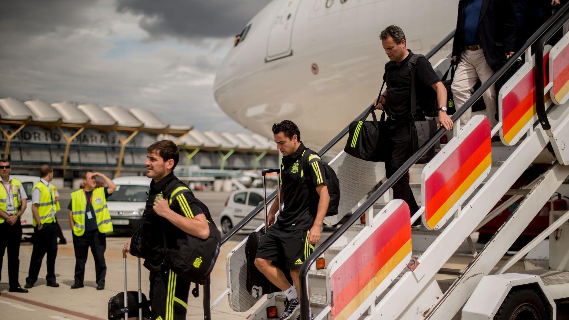 Iker Casillas (L) and Xavi Hernandez of Spain arrive at Barajas-Adolfo Suarez Airport on June 24, 2014 in Madrid, Spain.