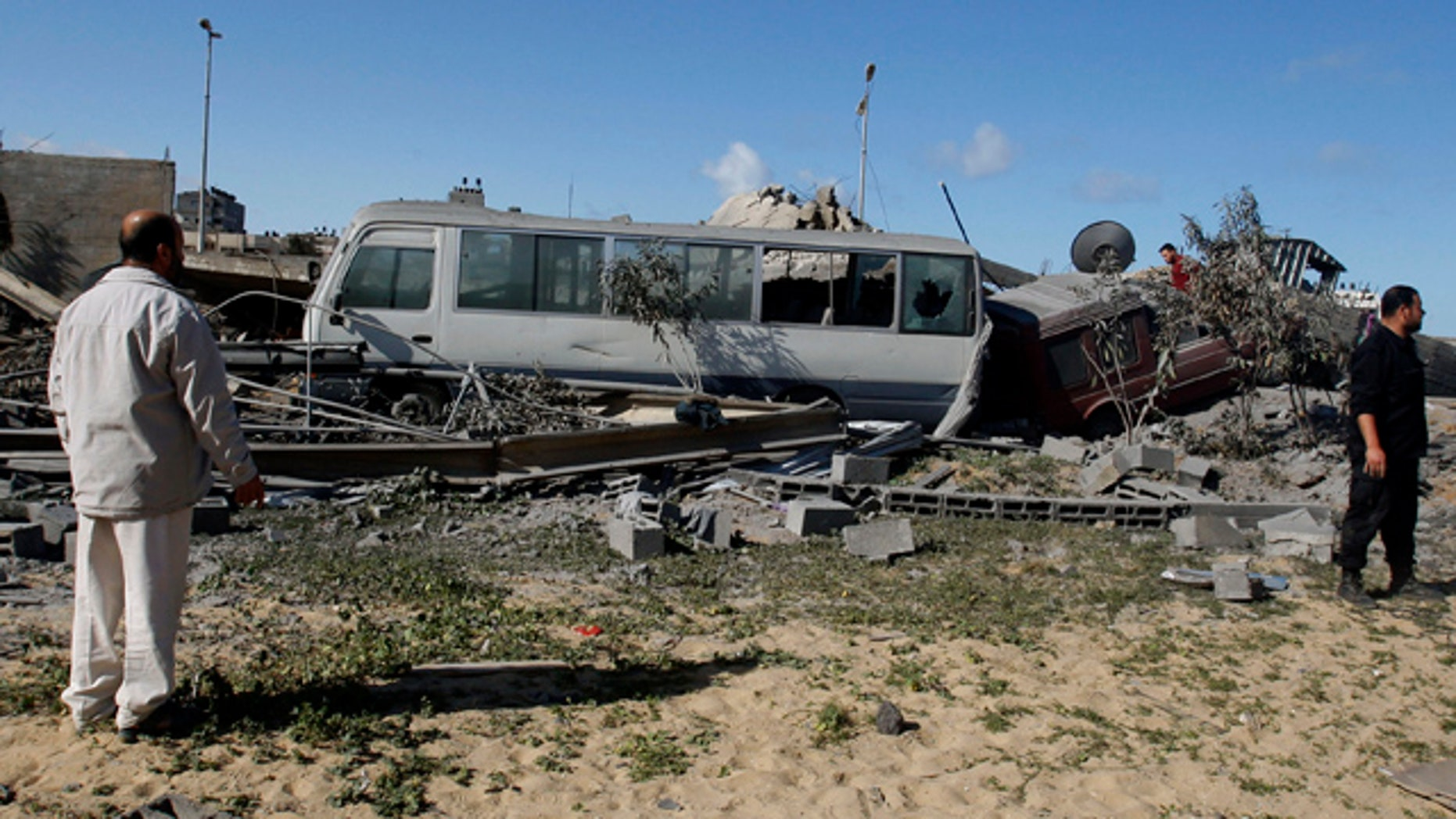 March 22: Hamas security men inspect the damage at a Hamas training camp following an Israeli air strike in Gaza City.