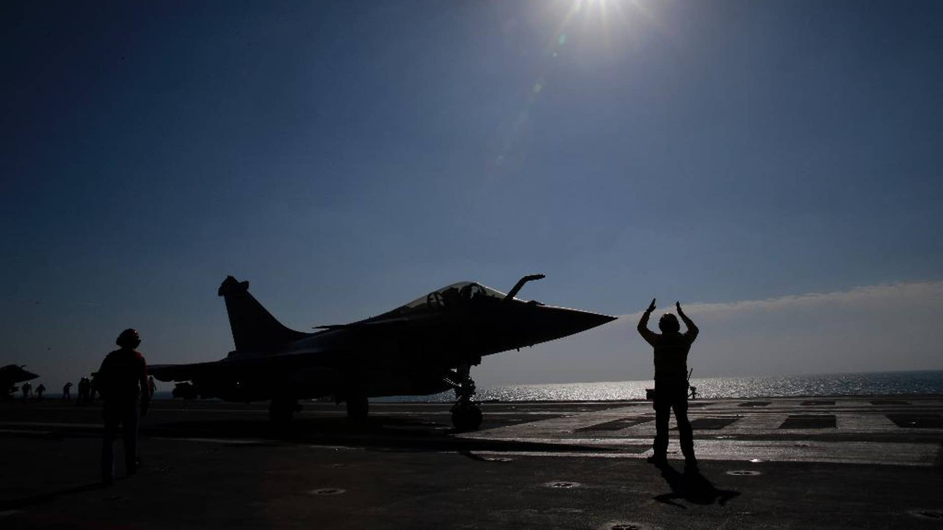 FILE - In this Jan.12, 2016 file photo, a Rafale jet fighter is catapulted on France's flagship Charles de Gaulle aircraft carrier in the Persian Gulf. French warplanes are flying over Iraq Friday Sept. 30, 2016 after France's Charles de Gaulle aircraft carrier rejoined the U.S.-led fight against Islamic State extremists and the coalition prepares to try to take back the city of Mosul. (AP Photo/Christophe Ena, File)