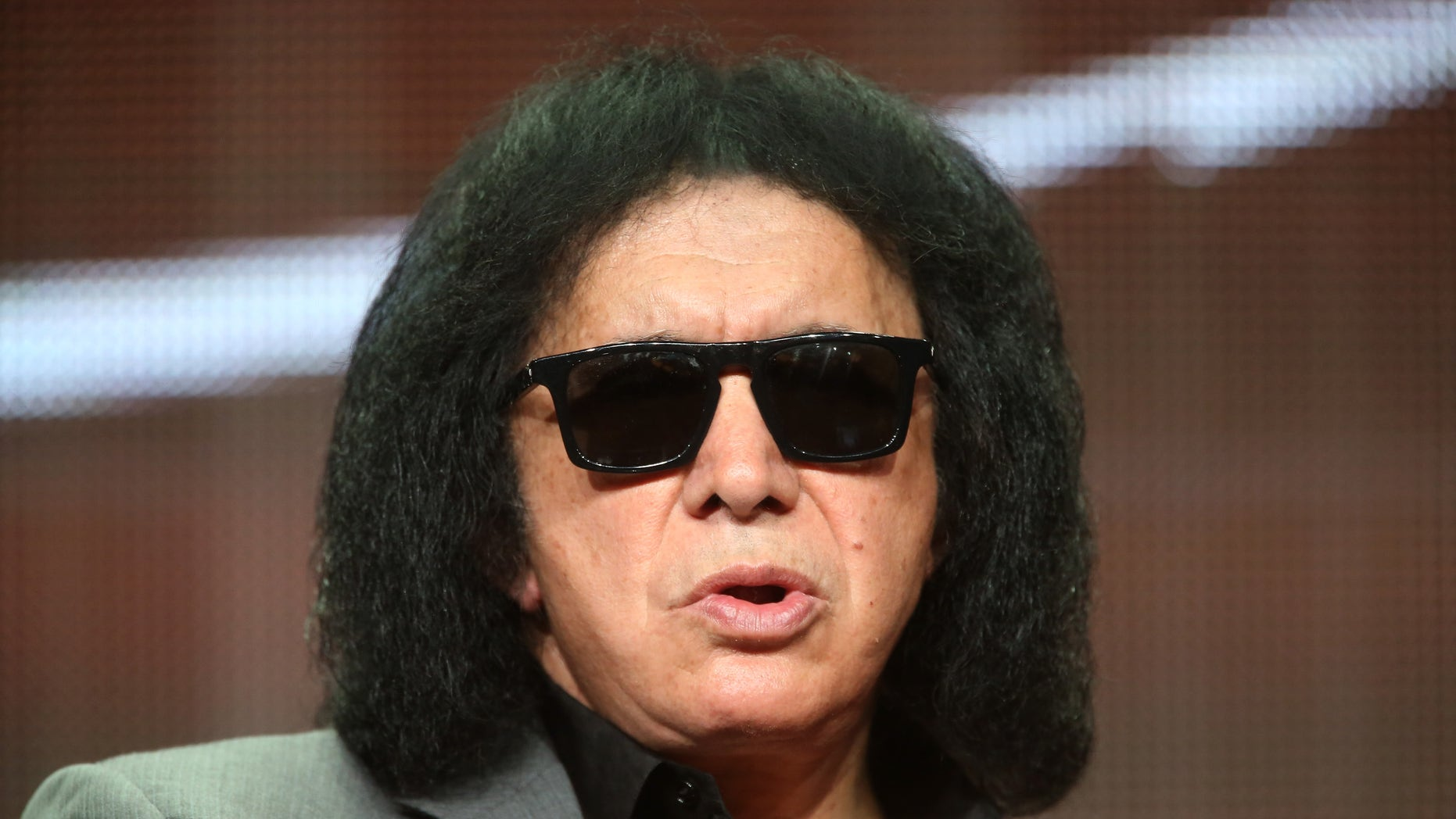 """BEVERLY HILLS, CA - JULY 11:  TV personality/musician Gene Simmons speaks onstage at the """"4th and Loud"""" panel during the AMC Networks portion of the 2014 Summer Television Critics Association at The Beverly Hilton Hotel on July 11, 2014 in Beverly Hills, California.  (Photo by Frederick M. Brown/Getty Images)"""