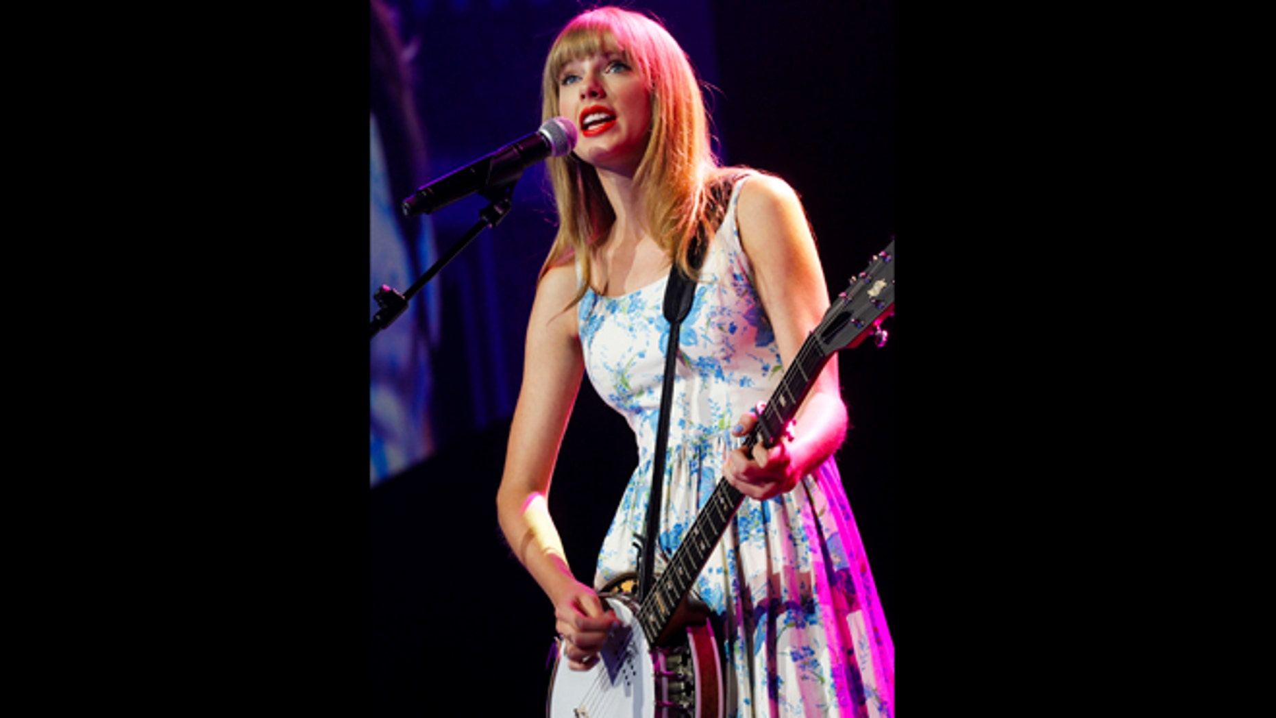 June 1, 2012: Taylor Swift performs during the annual Wal-Mart shareholders' meeting in Fayetteville, Arkansas.