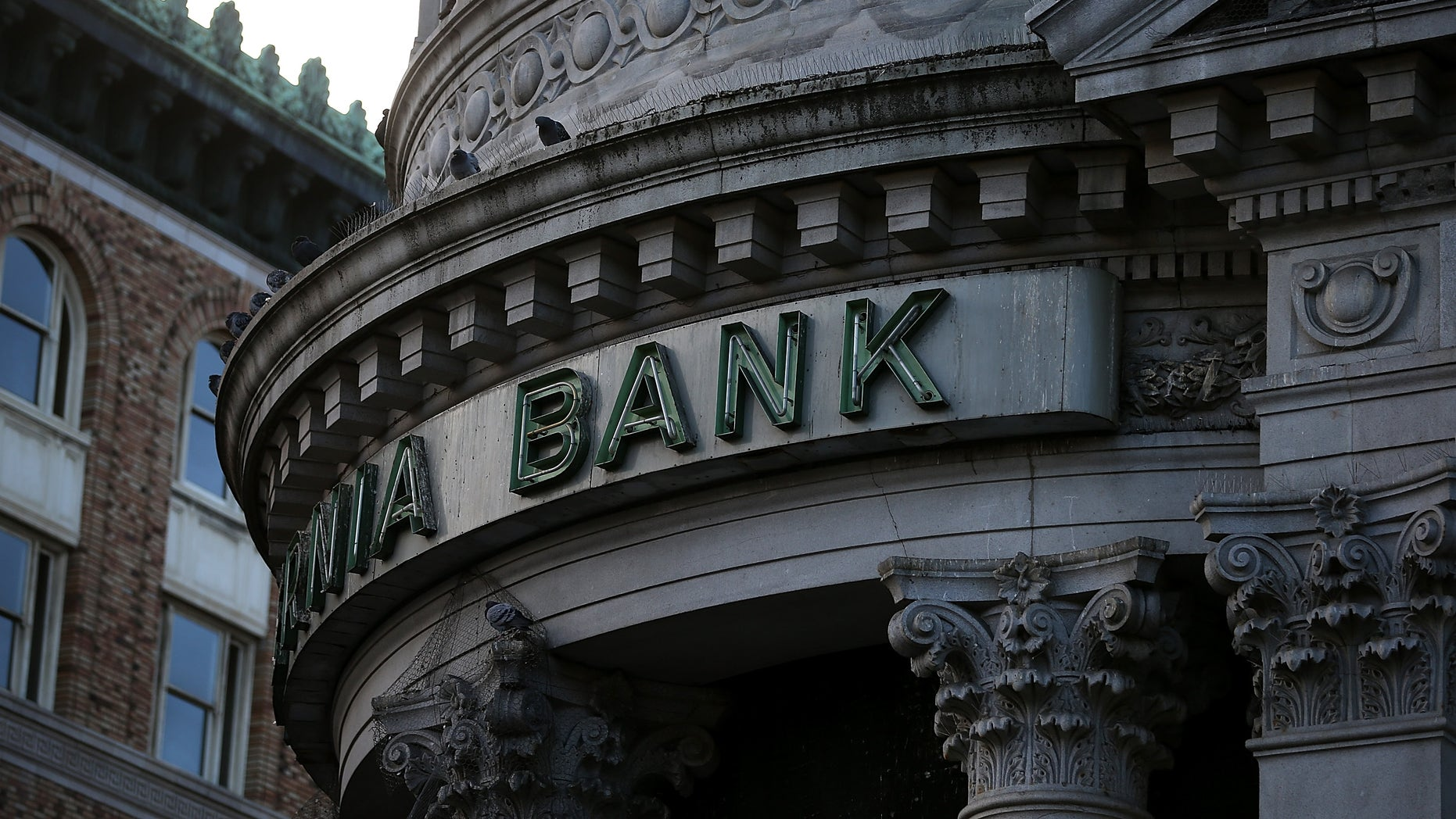 SAN FRANCISCO, CA - DECEMBER 03:  A sign remains on the exterior of a shuttered Hibernia Bank on December 3, 2013 in San Francisco, California.  According to the Federal Deposit Insurance Corp., the number of federally insured  banking institutions in the United States has shrunk to 6,891, down from a high of over 18,000. A majority of the decline occured between 1984 and 2011 with over 10,000 banks failing, or merging with bigger institutions.  (Photo by Justin Sullivan/Getty Images)