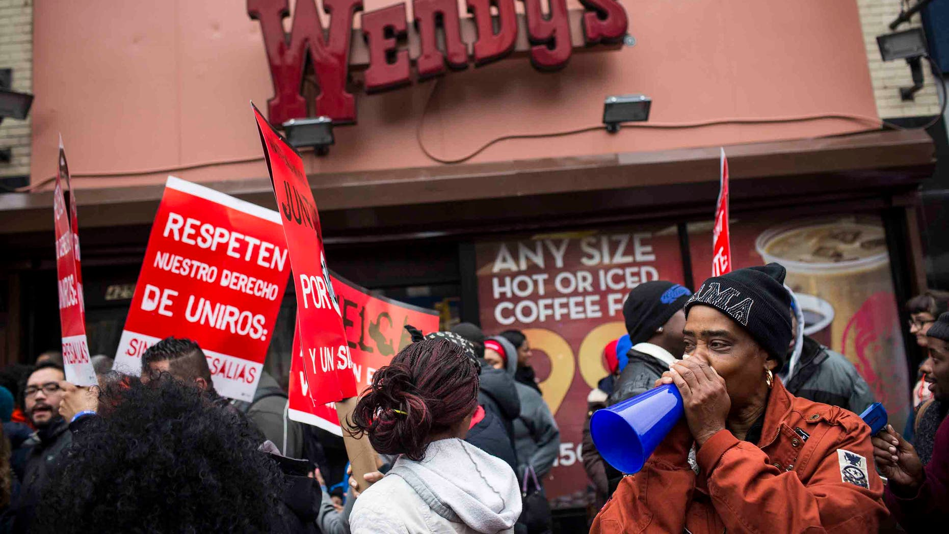 NEW YORK, NY - DECEMBER 05:  Protesters rally outside of a Wendy's in support of raising fast food wages from $7.25 per hour to $15.00 per hour on December 5, 2013 in the Brooklyn borough of New York City. A growing number of fast food workers in the United States have been staging protests outside restaurants, calling for a raise in wages, claiming it is impossible to live resonably while earning minimum wage.  (Photo by Andrew Burton/Getty Images)