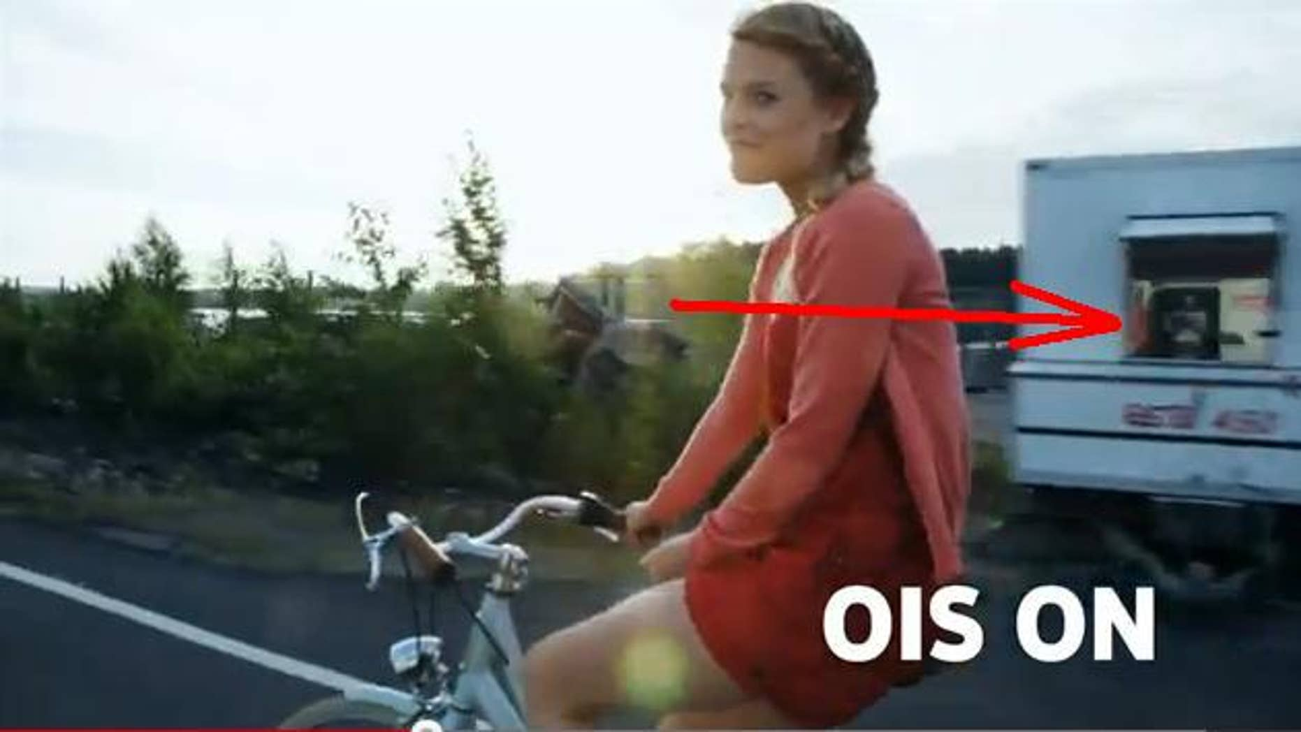 A still image from a promotional video for the Nokia 920, ostensibly shot by the phone itself, reveals the actual camera rig in a passing window.
