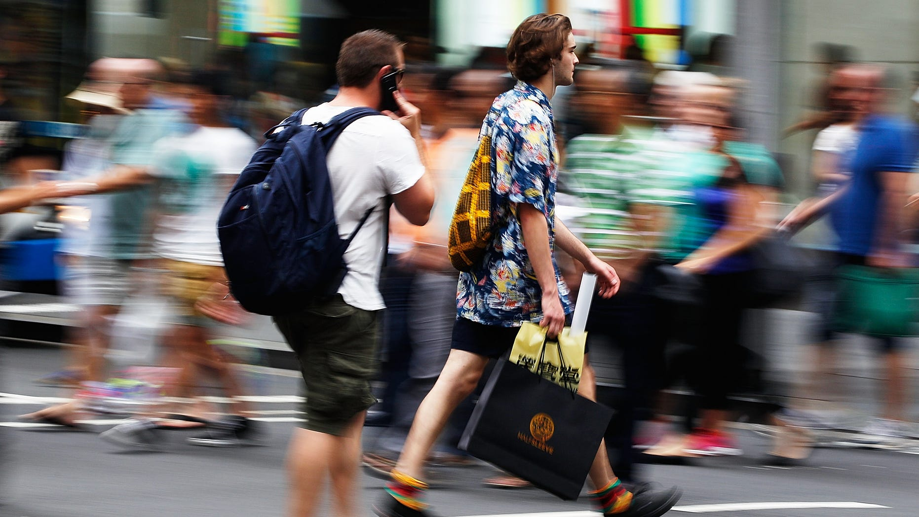 SYDNEY, AUSTRALIA - DECEMBER 23:  Shoppers flock to stores as retailers experience boost in sales on December 23, 2013 in Sydney, Australia. Australian retailers experience some of their busiest trades in the days leading up to Christmas with atleast $20 billion spent already. (Photo by Brendon Thorne/Getty Images)