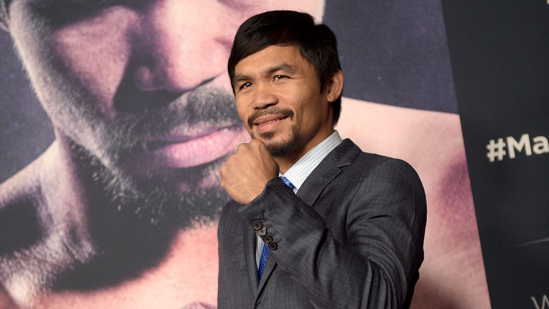 "HOLLYWOOD, CA - JANUARY 20:  Professional boxer Manny Pacquiao attends the premiere of ""Manny"" at TCL Chinese Theatre on January 20, 2015 in Hollywood, California.  (Photo by Jason Kempin/Getty Images)"
