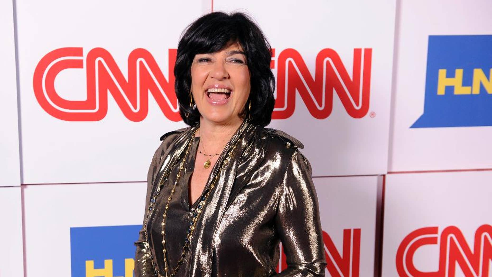 FILE- In this Jan. 10, 2014, file photo, Christiane Amanpour of CNN reacts to photographers at the CNN Worldwide All-Star Party in Pasadena, Calif. Amanpour, who is CNN's chief international correspondent, is scheduled to speak Friday, May 5, 2017, at Northeastern's graduation ceremony at TD Garden arena in Boston. (Photo by Chris Pizzello/Invision/AP, File)