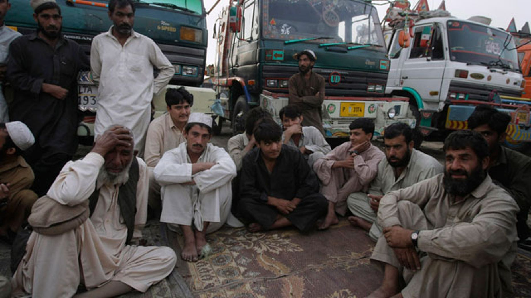 Dec. 8, 2011: Pakistani truck drivers and their assistants gather at a terminal in Karachi, Pakistan. Pakistan closed its two Afghan crossings in Chaman and Torkham, in the northwest Khyber tribal area, almost immediately after NATO aircraft attacked two army posts along the border before dawn on Nov. 26.