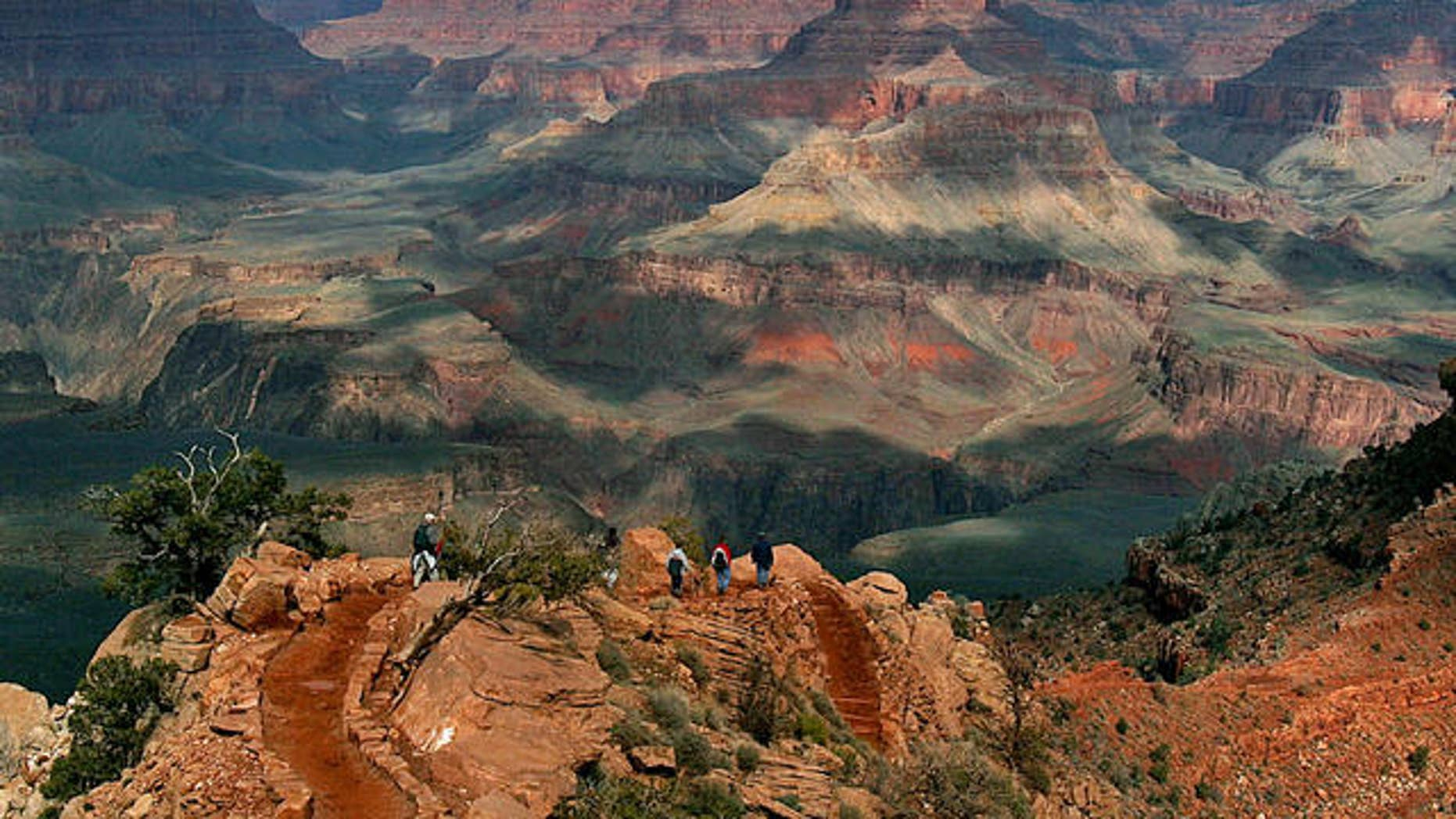 With the North Rim in the background, tourists hike along the South Rim of the Grand Canyon Tuesday, Feb. 22, 2005.