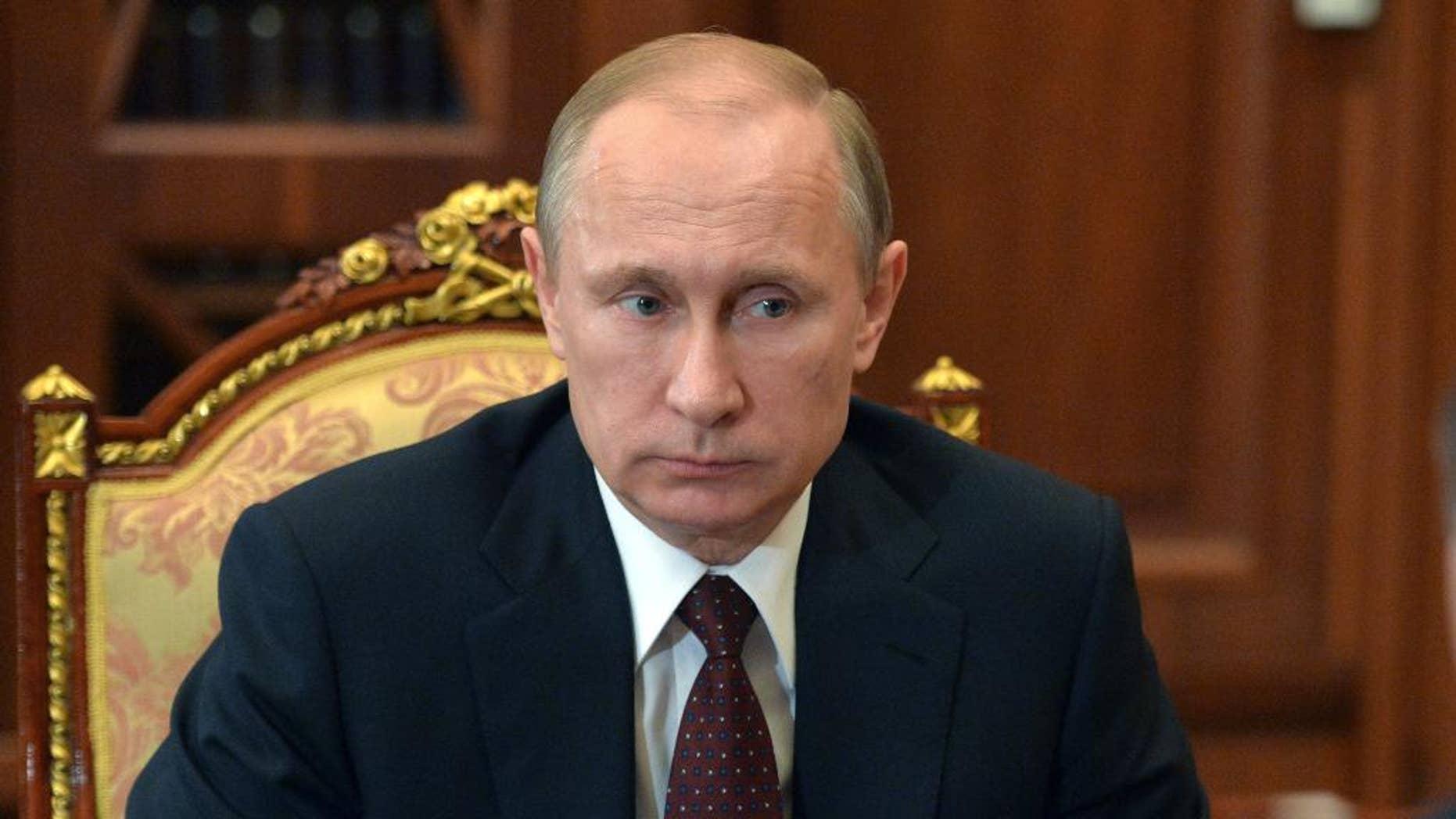 Russian President Vladimir Putin listens during a meeting at the Kremlin, in Moscow, Russia, Tuesday, March 10, 2015.(AP Photo/RIA Novosti, Alexei Druzhinin, Presidential Press Service)
