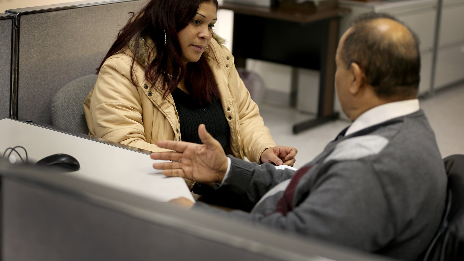 NORTH MIAMI, FL - JANUARY 07: Job seeker, Jennifer Quinones, speaks with career specialists, Shehata Ali, at a Workforce One Employment Solutions center as she looks for a job after being out of work for more than a year on January 7, 2014 in North Miami, Florida. In Washington, DC today a bipartisan measure in the Senate to extend the Emergency Unemployment Compensation (EUC) program for three months passed a procedural vote.  (Photo by Joe Raedle/Getty Images)