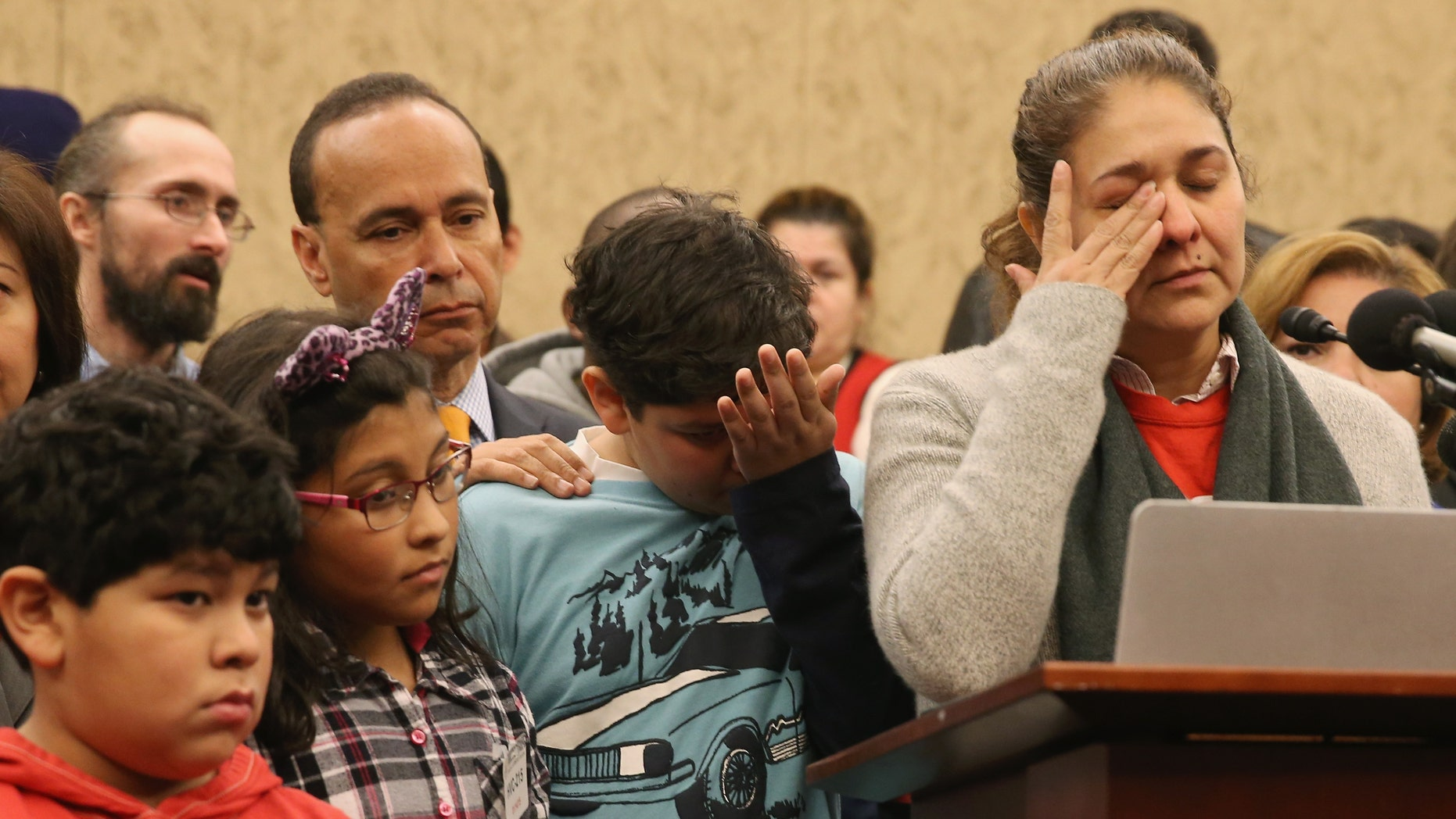 WASHINGTON, DC - JANUARY 14: Isabel Aguilar (R) speaks about immigration while flanked by her children Adolfo Martinez 13 (C), Miranda Aguilar 8 (2ndL), and Emillio Aguilar 7 (L), during a news conference on Capitol Hill, January 14, 2015 in Washington, DC. Ms. Aguilar joined House Democrats to urge members of Congress not to pass legislation to fund the Department of Homeland Security with attached anti-immigrant amendments. (Photo by Mark Wilson/Getty Images)
