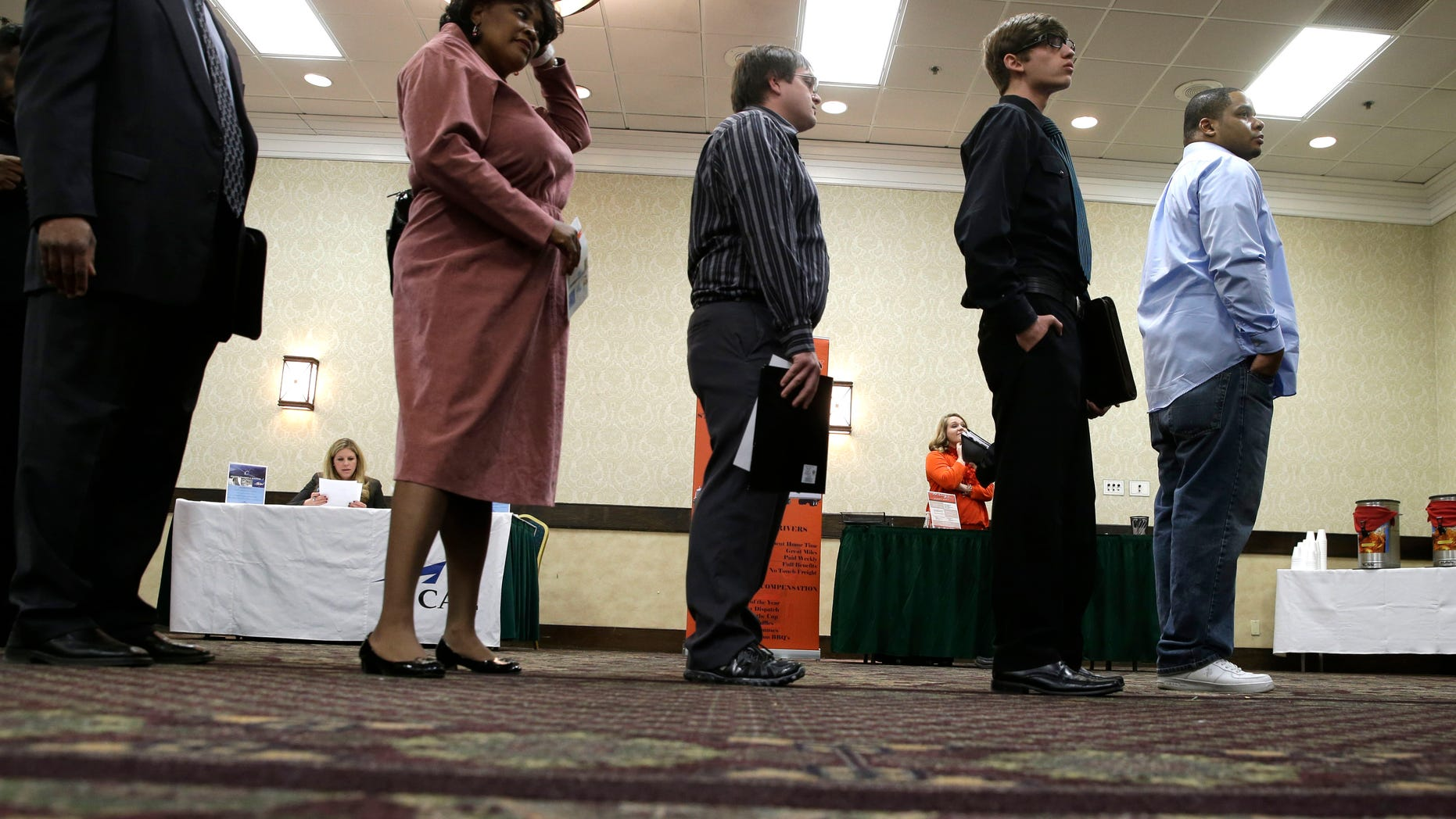 In this Wednesday, Jan. 22, 2014, photo, job seekers line up to meet a prospective employer at a career fair at a hotel in Dallas. Payroll processor ADP reports on job growth at U.S. companies in January on Wednesday, Feb. 5, 2014. (AP Photo/LM Otero)
