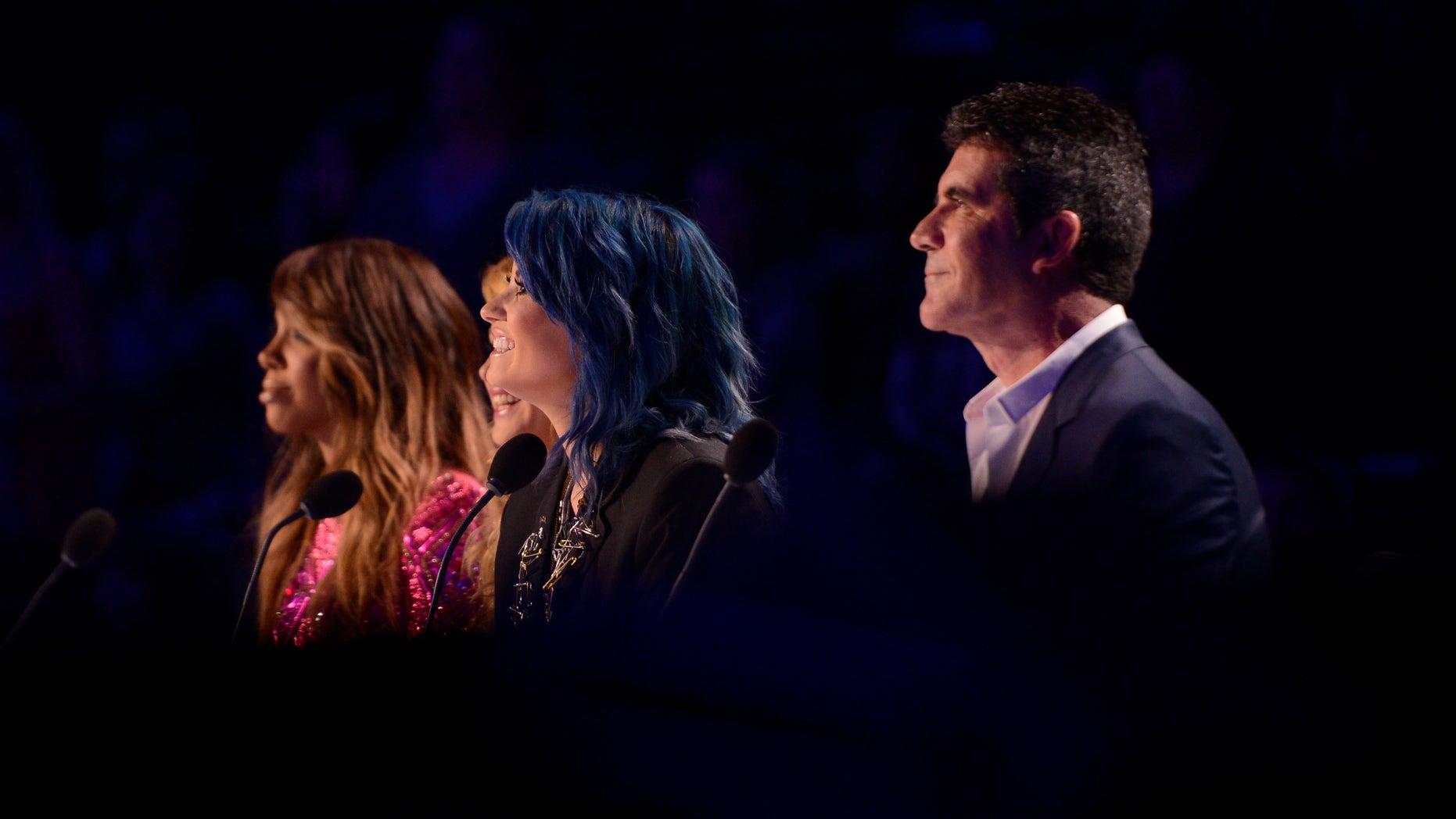 Kelly Rowland, Paulina Rubio, Demi Lovato and Simon Cowell on THE X FACTOR airing Thursday Nov. 21, 2013.