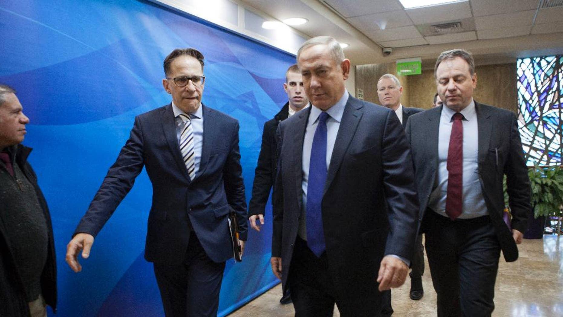 Israeli Prime Minister Benjamin Netanyahu, second right, arrives for a weekly cabinet meeting in Jerusalem, Sunday, Dec. 25, 2016. (Dan Balilty/Pool photo via AP)