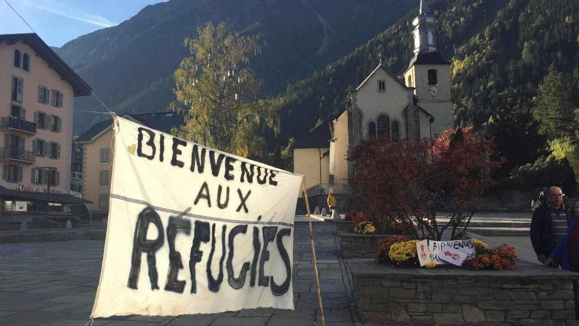"A banner set up in the main square of Chamonix, in the French Alps, reads ""Welcome to Refugees"" Saturday, two days before the dismantling of a refugee camp known as ""The Jungle"" in Calais."
