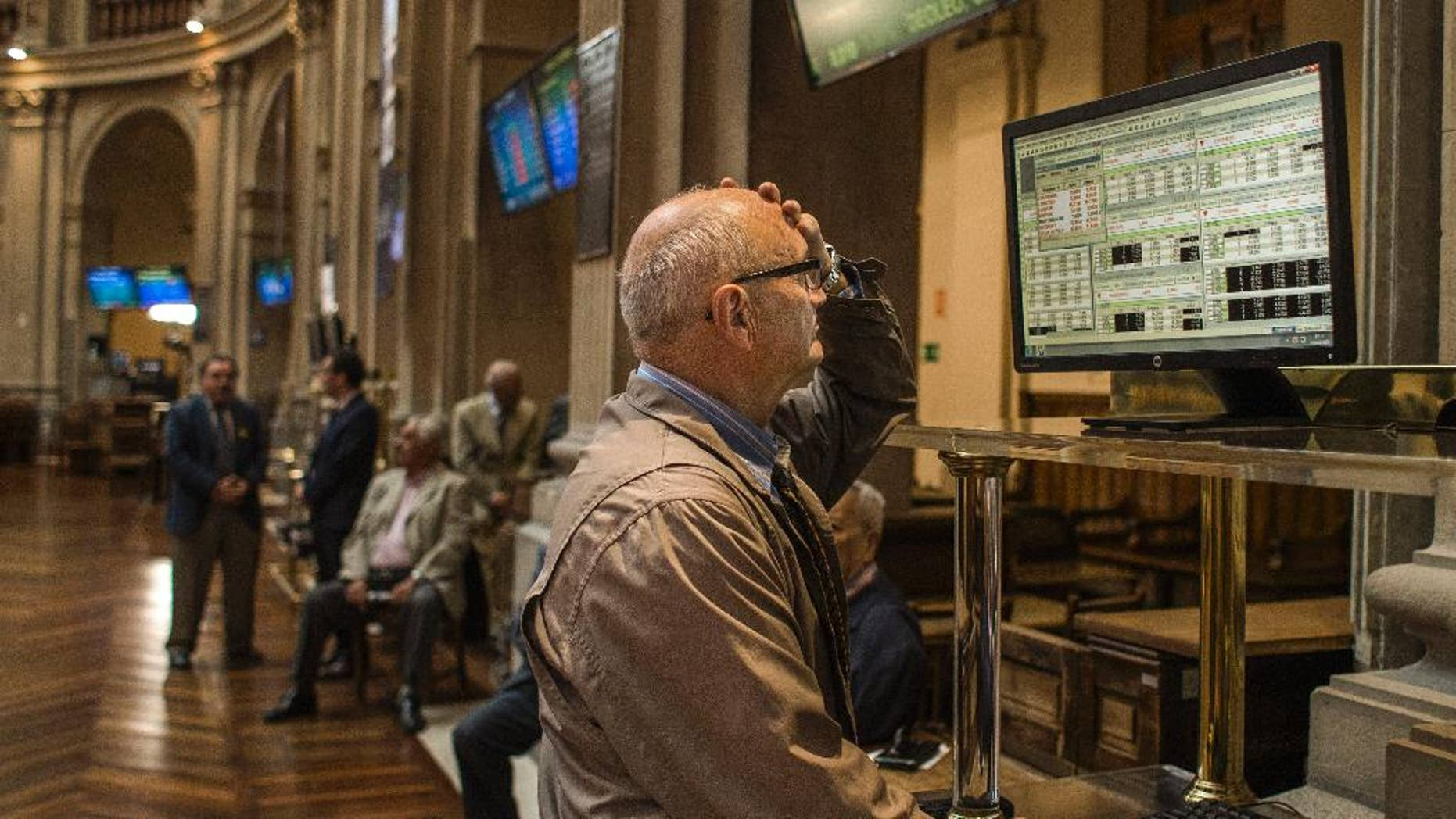 A broker gestures as he looks at a screen at the Stock Exchange in Madrid, Monday, June 29, 2015. Spain's economy minister has said a Greek debt deal is still reachable before a deadline on the nation's credit from the European Central Bank runs out at midnight Tuesday. Spain's benchmark Ibex stock index slid nearly 4 percent Monday morning. (AP Photo/Andres Kudacki)