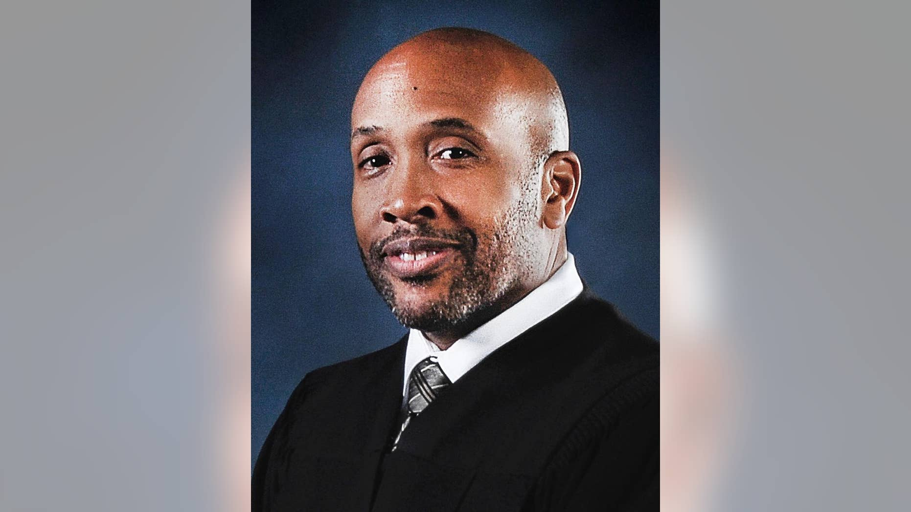 In this undated photo released by the Maryland Judiciary Office of Communications and Public Affairs, Baltimore Circuit Judge Barry Williams poses for a photo. Judge Williams  who's overseeing the emotionally charged case of a young black man who died in police custody is a former federal prosecutor who used to put dirty police officers on trial. Friends and colleagues describe Baltimore Circuit Judge Williams as an even-handed judge who has a sense of humor but doesn't tolerate any courtroom grandstanding. People on both sides of the Freddie Gray case agree that he is the best judge for the job.(Maryland Judiciary Office of Communications and Public Affairs via AP)