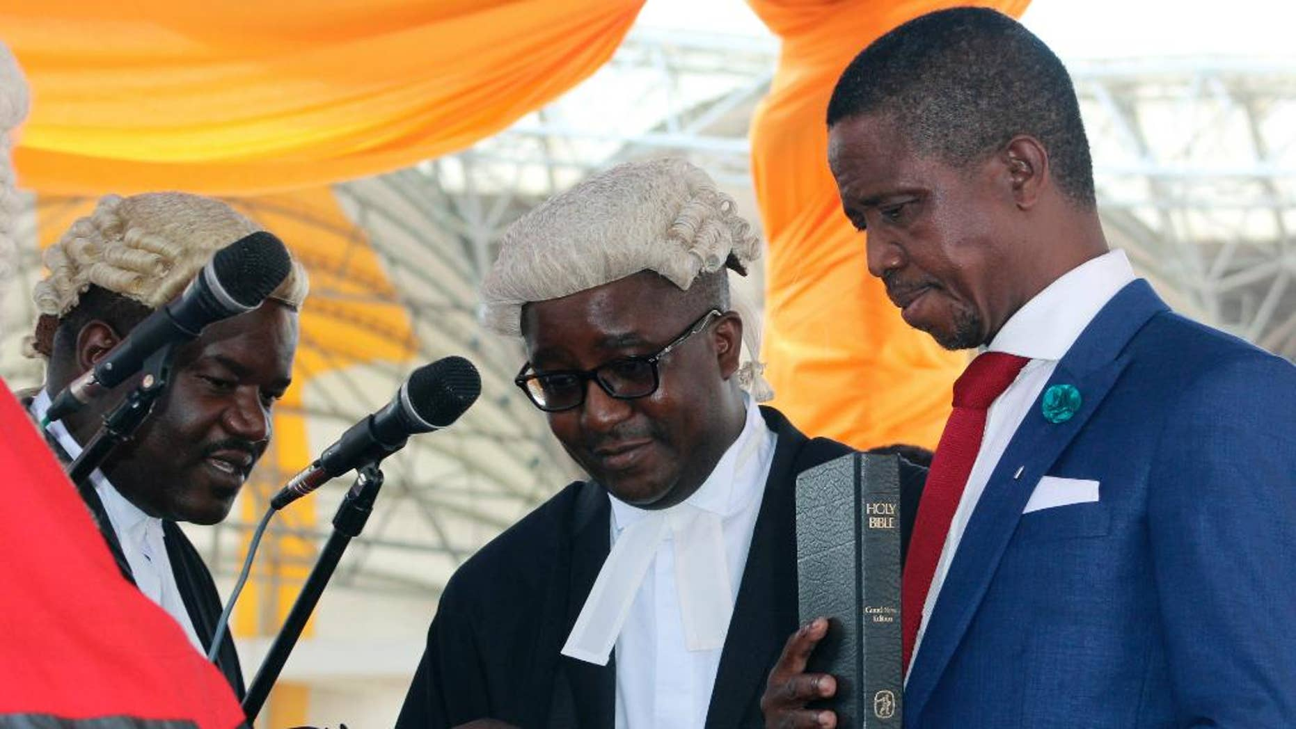 Jan. 25, 2015: Newly-elected Zambian president, Edgar Lungu, right, is sworn into office during an inauguration ceremony in Lusaka.  (AP)