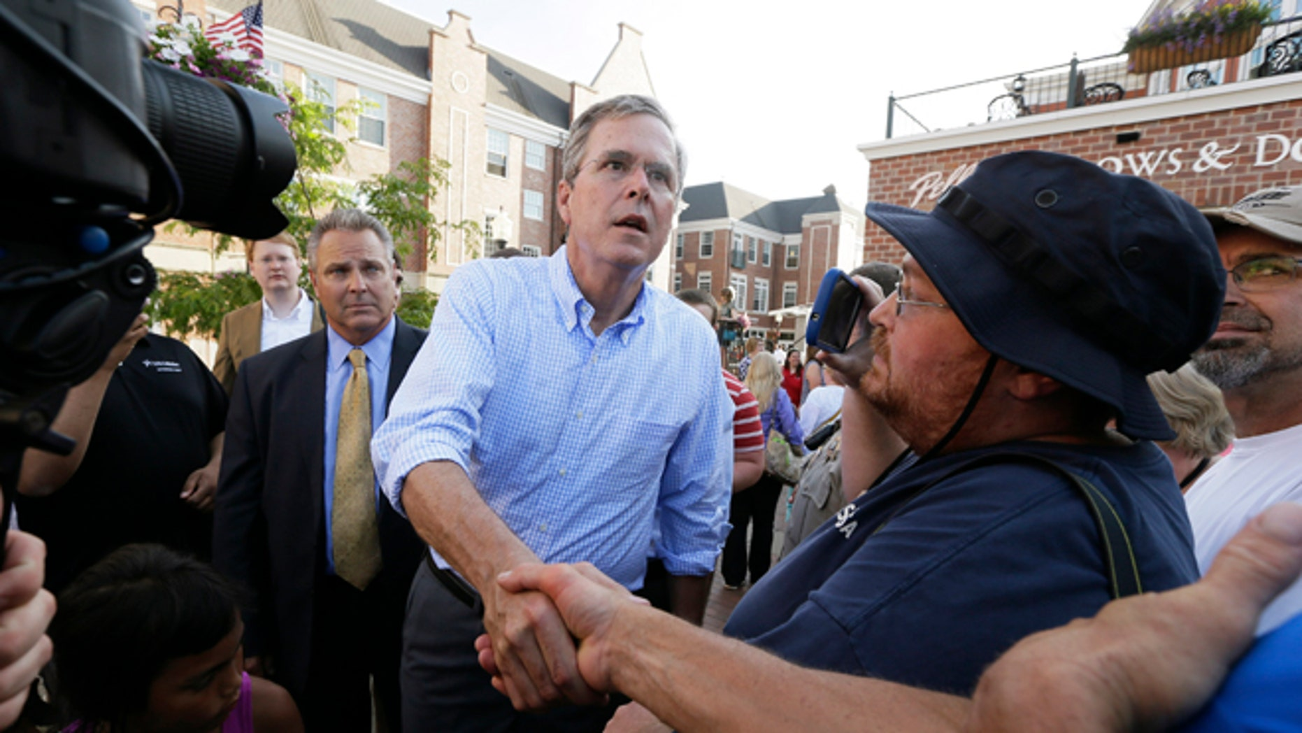 Republican presidential candidate Jeb Bush greets supporters following a town hall meeting, Wednesday, June 17, 2015, in Pella, Iowa. (AP Photo/Charlie Neibergall)