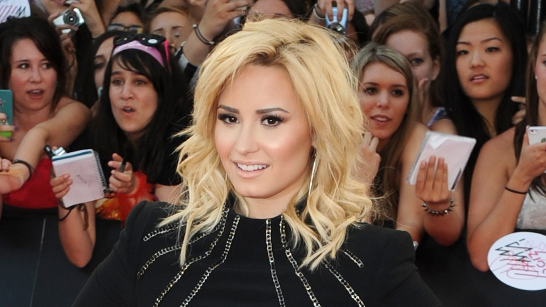 TORONTO, ON - JUNE 16:  Demi Lovato  arrives on the red carpet at the 2013 MuchMusic Video Awards at Bell Media Headquarters on June 16, 2013 in Toronto, Canada.  (Photo by Jag Gundu/Getty Images)
