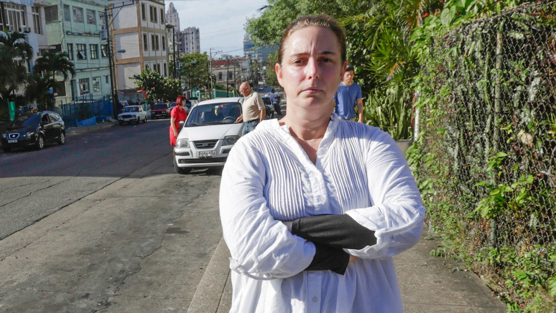 Cuban performance artist Tania Bruguera poses for a picture in a street of Havana, on December 31, 2014, upon her released from a police station.