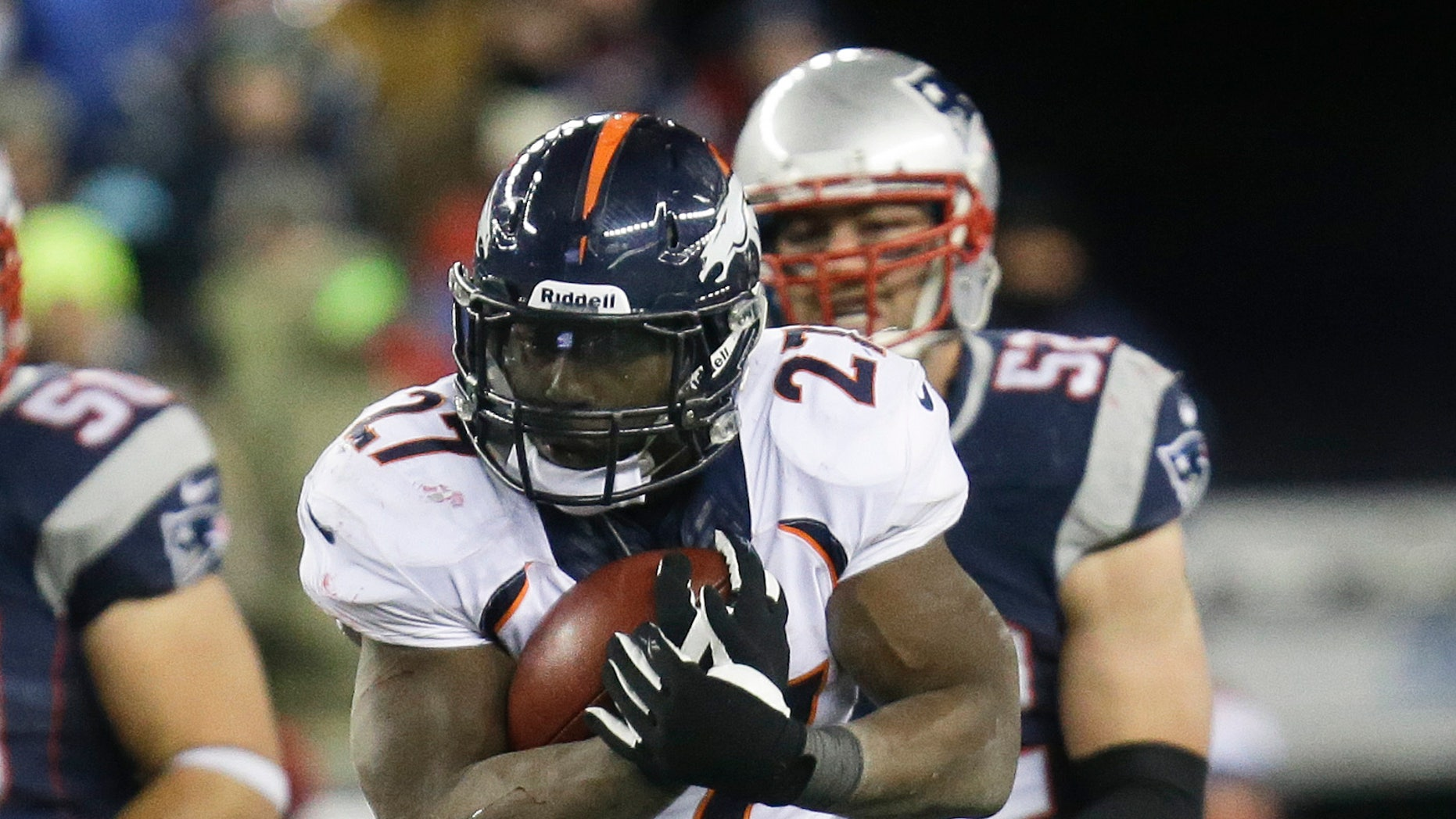 Denver Broncos running back Knowshon Moreno runs against the New England Patriots during overtime of an NFL football game Sunday, Nov. 24, 2013, in Foxborough, Mass. The Patriots won 34-31 in overtime. (AP Photo/Steven Senne)