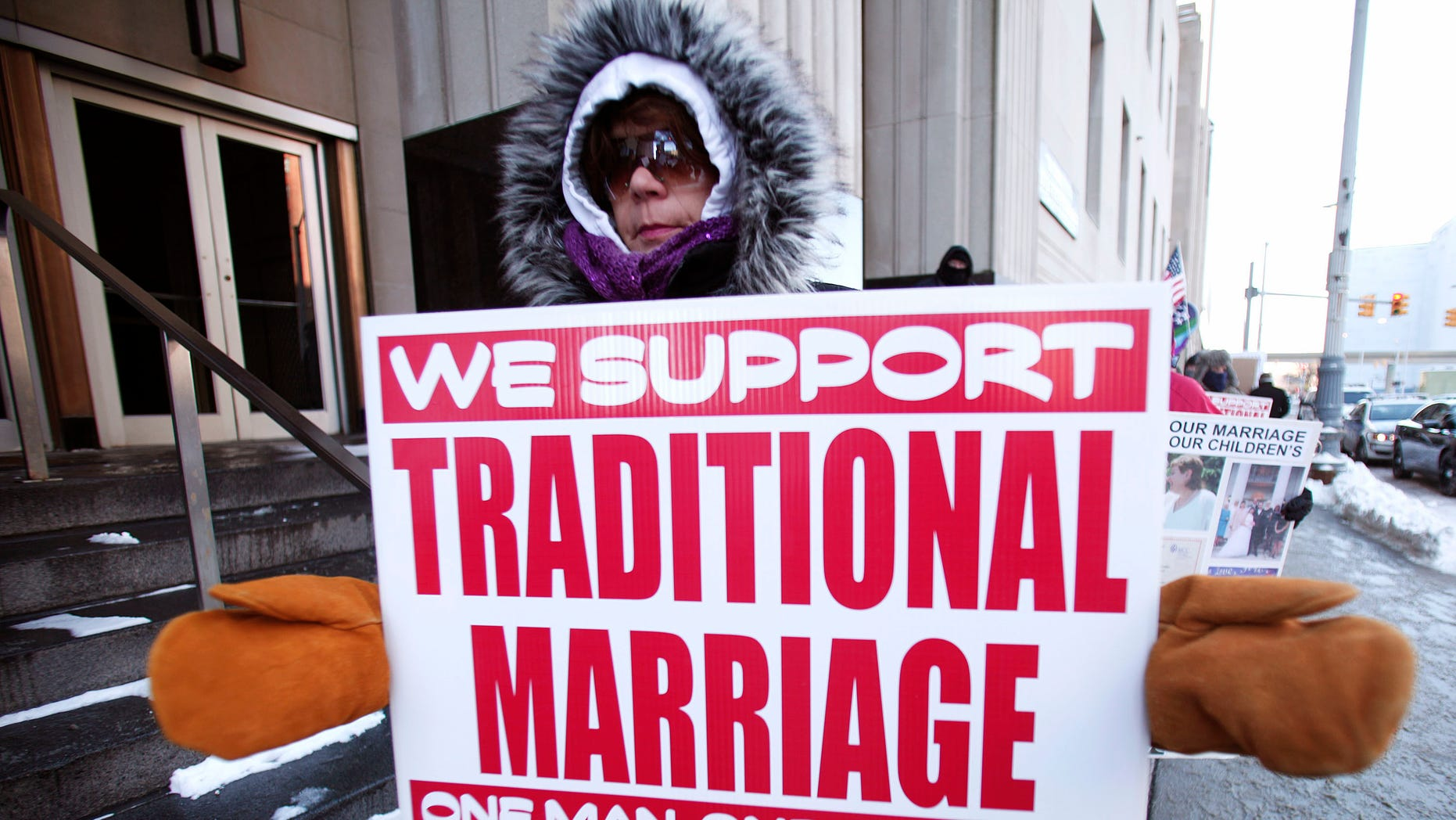 DETROIT, MI - MARCH 3: An advocate of traditional marriage protests in front of the U.S. Federal Courthouse March 3, 2014 in Detroit, Michigan. Plaintiffs Jayne Rowse and April DeBoer, a gay couple, have filed suit in Federal Court in an attempt to have Michigan's ban on gay marriage and gay adoption overturned. Current Michigan law defines marriage as the union between one man and one woman. (Photo by Bill Pugliano/Getty Images)