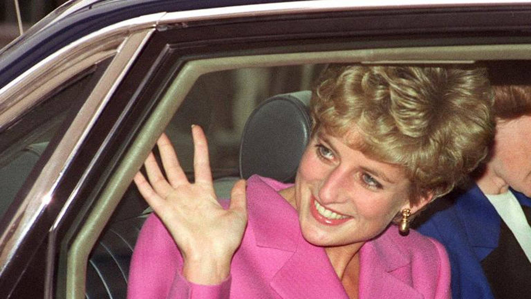 Diana, Princess of Wales waves to the crowd as she arrives at the Cite de la Musique at La Villette in Paris on November 14, 1992