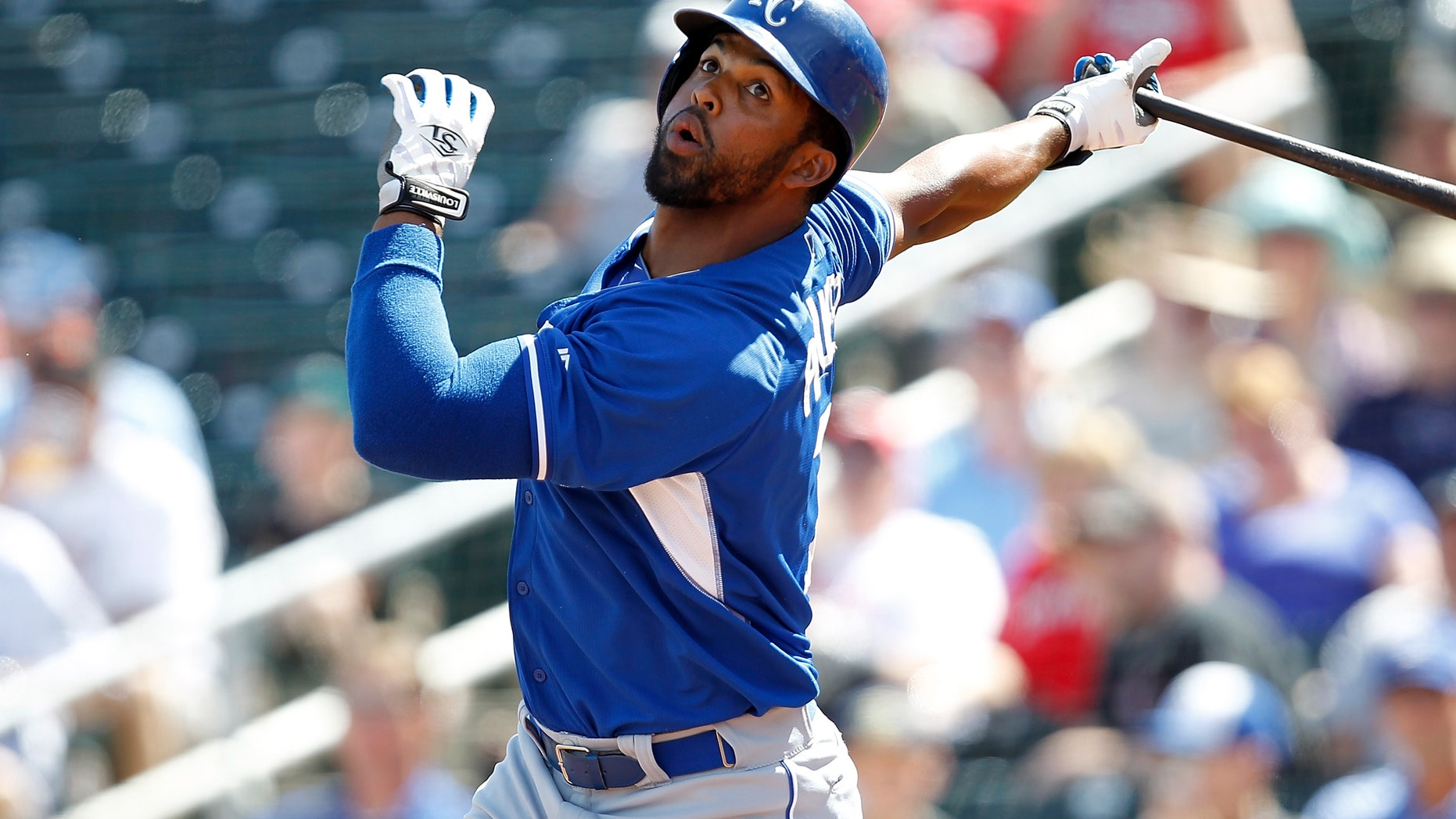 GOODYEAR, AZ - MARCH 21: Carlos Peguero #7 of the Kansas City Royals hits during a game against the Cincinnati Reds at Goodyear Ballpark on March 21, 2014 in Goodyear, Arizona. The Cincinnati Reds defeated the Kansas City Royals 9-3. (Photo by Sarah Glenn/Getty Images)