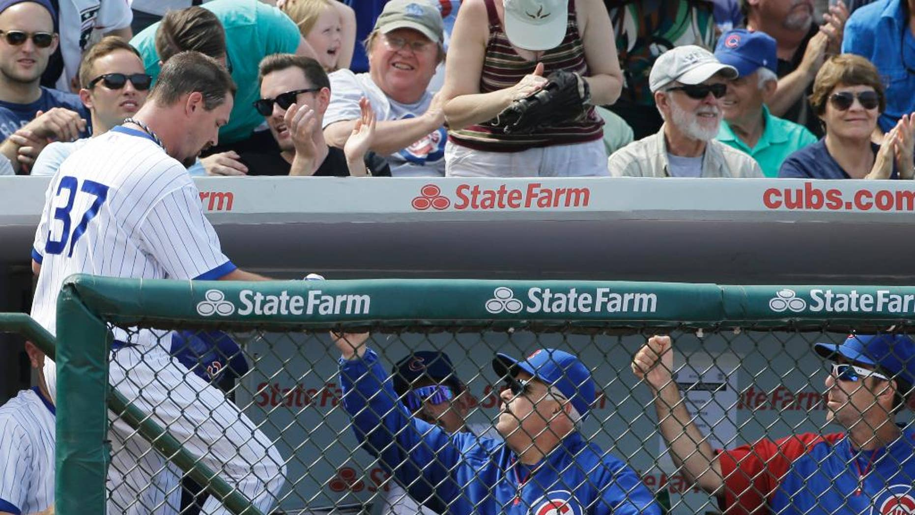 Chicago Cubs' Travis Wood, left, celebrates with manager Rick Renteria after scoring on a single hit by Javier Baez during the fifth inning of an interleague baseball game against the Tampa Bay Rays in Chicago, Sunday, Aug. 10, 2014. (AP Photo/Nam Y. Huh)