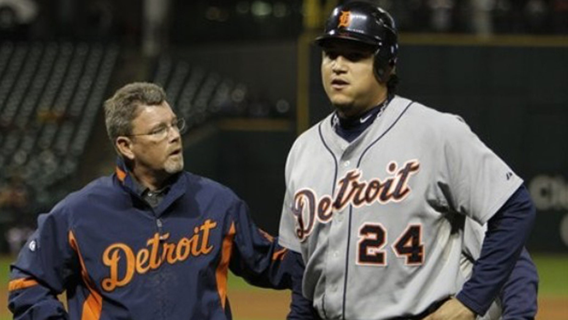Detroit Tigers' Miguel Cabrera (24) is helped off the field by trainer Kevin Rand after injuring himself diving back into first base on a pickoff attempt in the seventh inning of a baseball game against the Cleveland Indian on Monday, Sept. 27, 2010, in Cleveland.