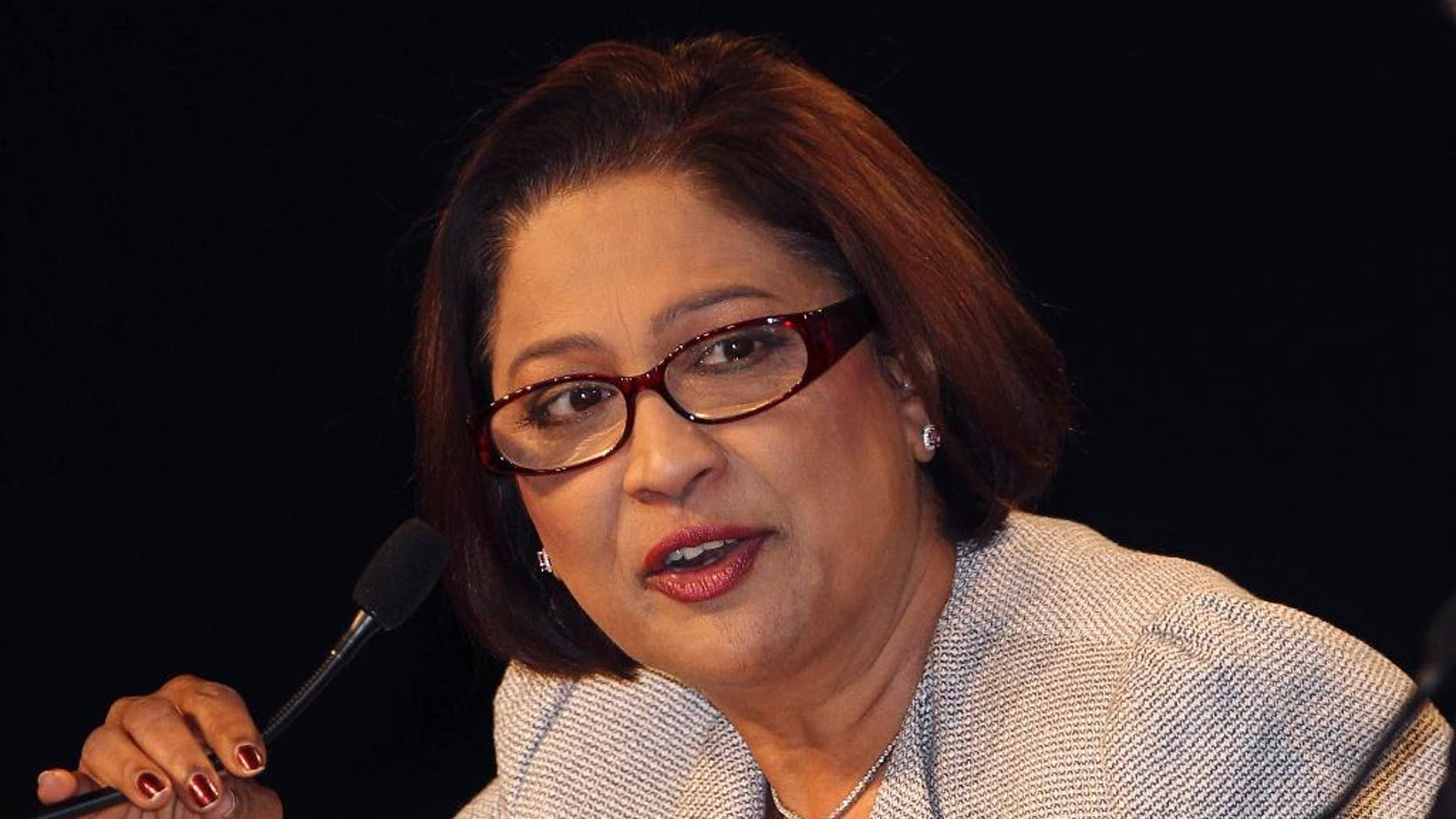 FILE - In this Oct. 30, 2011 file photo, Prime Minister of Trinidad and Tobago Kamla Persad-Bissessar speaks during a press conference at the end of the Commonwealth Heads Of Government Meeting (CHOGM) in Perth, Australia. Persad-Bissessar, the twin-island's first female prime minister, faces a tough re-election on Monday, Sept. 7, 2015 amid complaints that her government has tolerated corruption and failed to curb violent crime. (AP Photo/Rob Griffith, File)