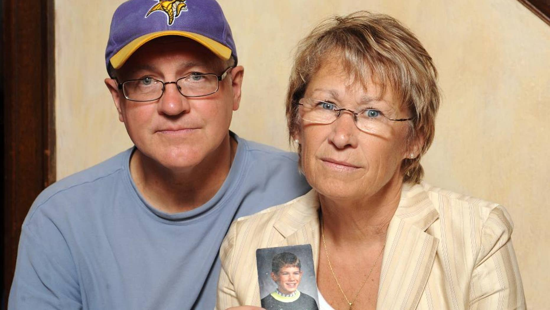 Patty and Jerry Wetterling with a photo of their son, Jacob.