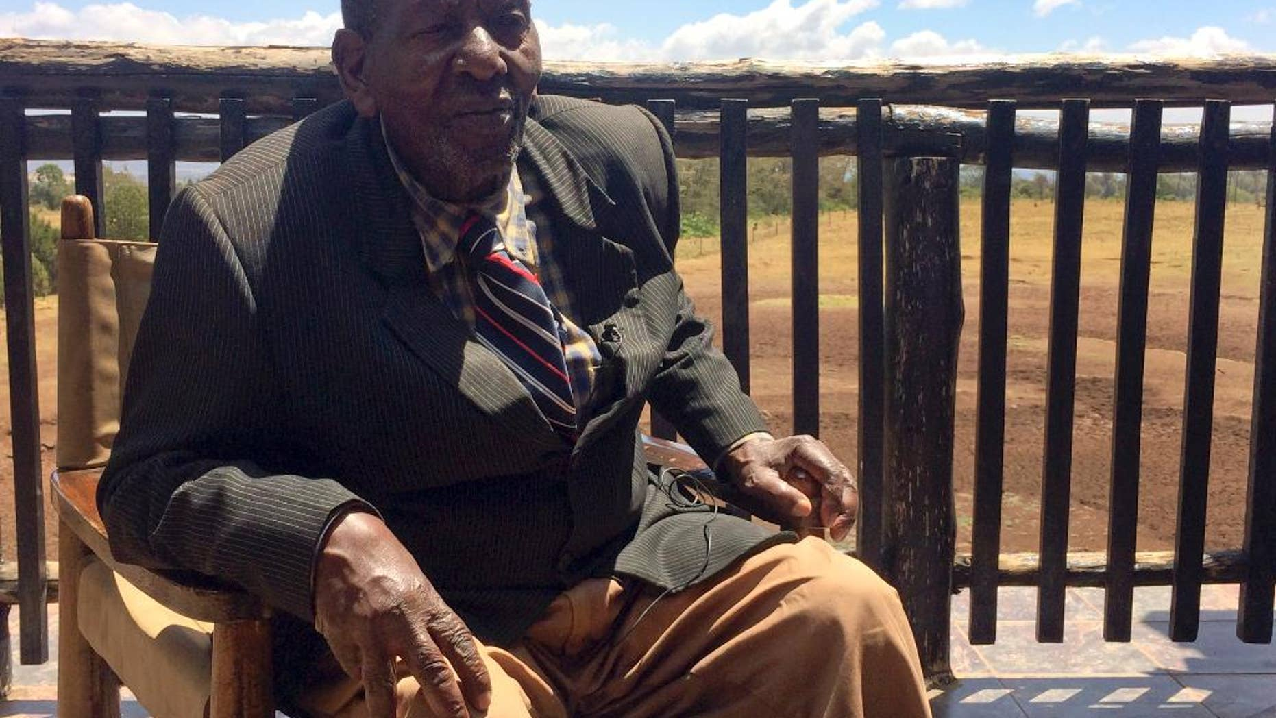 In this photo taken Sunday, Feb. 5, 2017, Nahashon Mureithi, 89, recollects his time as a porter and guide for Britain's Queen Elizabeth II, then Princess Elizabeth, at the Treetops hotel near Nyeri, in Kenya. Sixty-five years ago, Princess Elizabeth went up into the treehouse safari lodge watching elephants below, and was informed that her father had died and she descended from the treehouse a queen. (AP Photo/Andrew Njuguna)