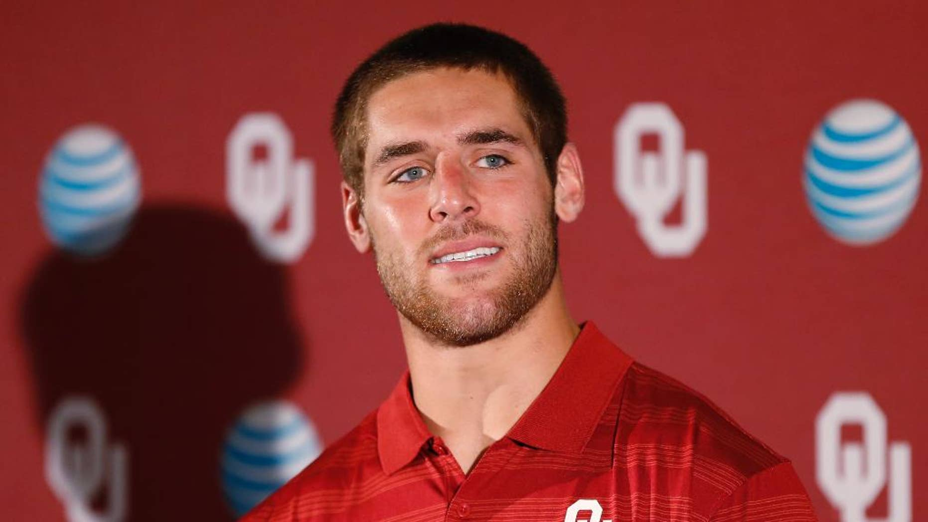 Oklahoma quarterback Trevor Knight answers a question during a news conference in Norman, Okla., Monday, Aug. 25, 2014. Some uncertainties have cleared up as No. 4 Oklahoma prepares to open the season Saturday against Louisiana Tech. (AP Photo/Sue Ogrocki)