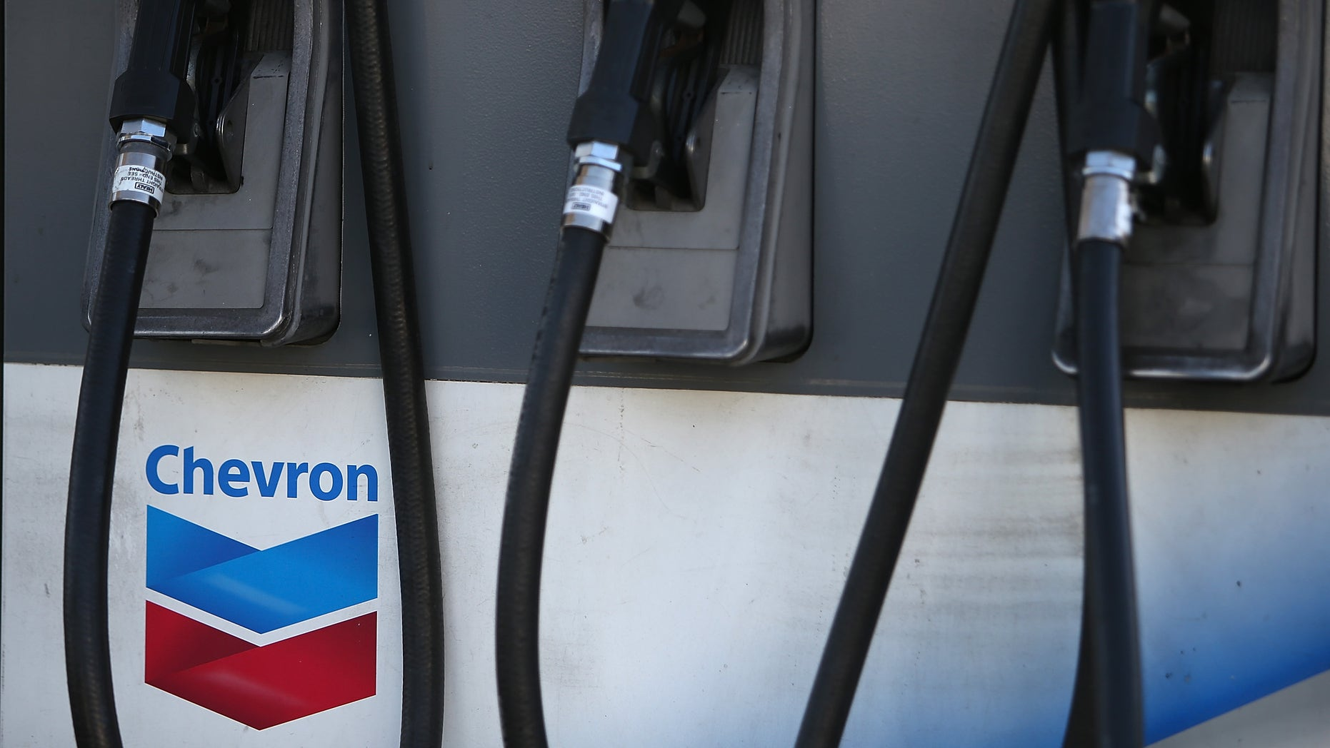 SAN FRANCISCO, CA - MAY 02:  The Chevron logo is displayed on a gas pump at a Chevron gas station on May 2, 2014 in San Francisco, California.  Chevron Corp. reported a 27 percent plunge in first quarter profits with earnings of $4.51 billion, or $2.36 a share, compare to $6.18 billion, or $3.18 a share, one year ago.  (Photo by Justin Sullivan/Getty Images)