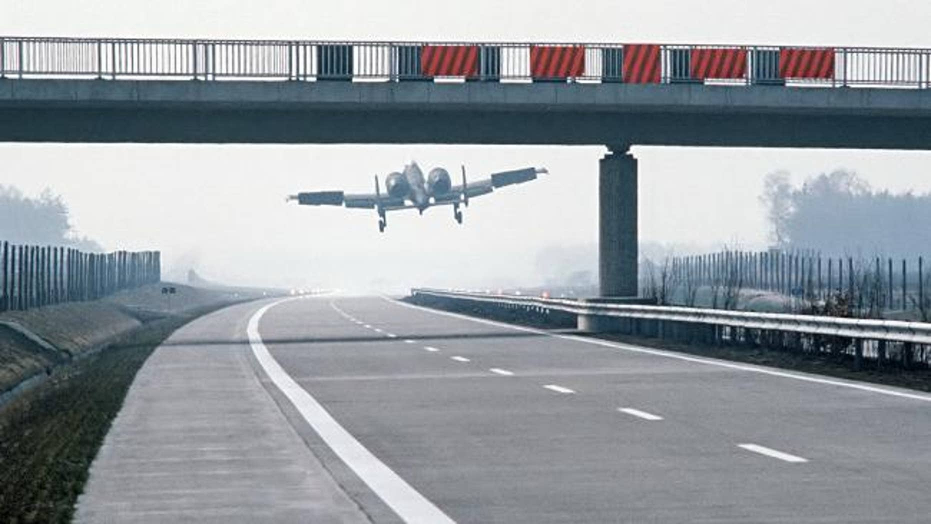 An A-10 Thunderbolt II lands on the German autobahn in the 1980s