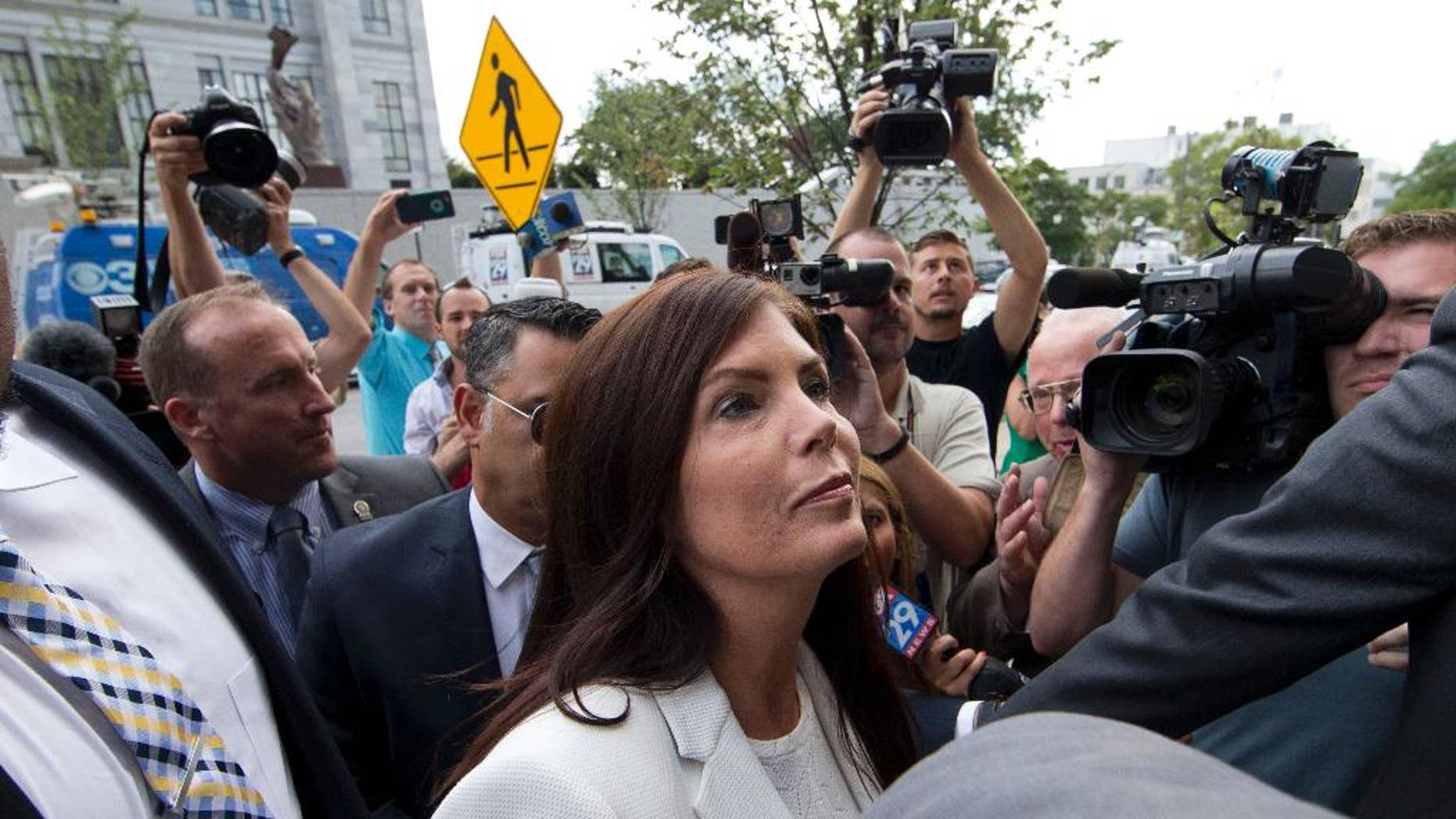 Pennsylvania Attorney General Kathleen Kane arrives to be processed and arraigned on charges she leaked secret grand jury material and then lied about it under oath, Saturday, Aug. 8, 2015, at the Montgomery County detective bureau in Norristown, Pa. Kane, the state's first elected female attorney general, vows to fight the charges, which include perjury, obstruction and conspiracy. (AP Photo/Matt Rourke)