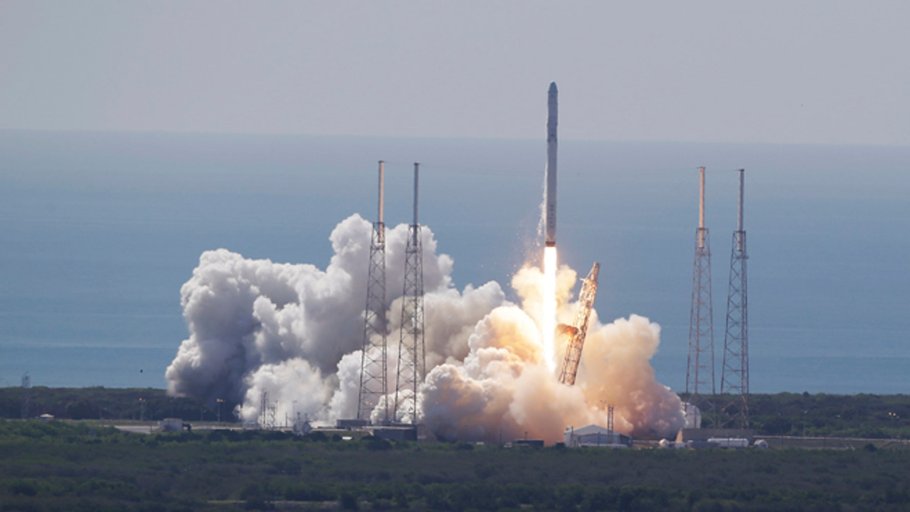 The SpaceX Falcon 9 rocket and Dragon spacecraft lifts off from Space Launch Complex 40 at the Cape Canaveral Air Force Station in Cape Canaveral, Fla., Sunday, June 28, 2015. The rocket carrying supplies to the International Space Station broke apart shortly after liftoff. (AP Photo/John Raoux)