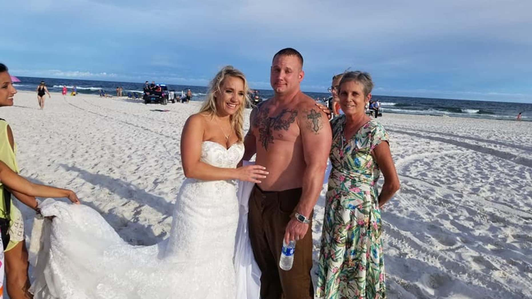 Moments after he got married, Coast Guard Petty Officer 2nd Class Zac Edwards saved a man from drowning on an Alabama beach.
