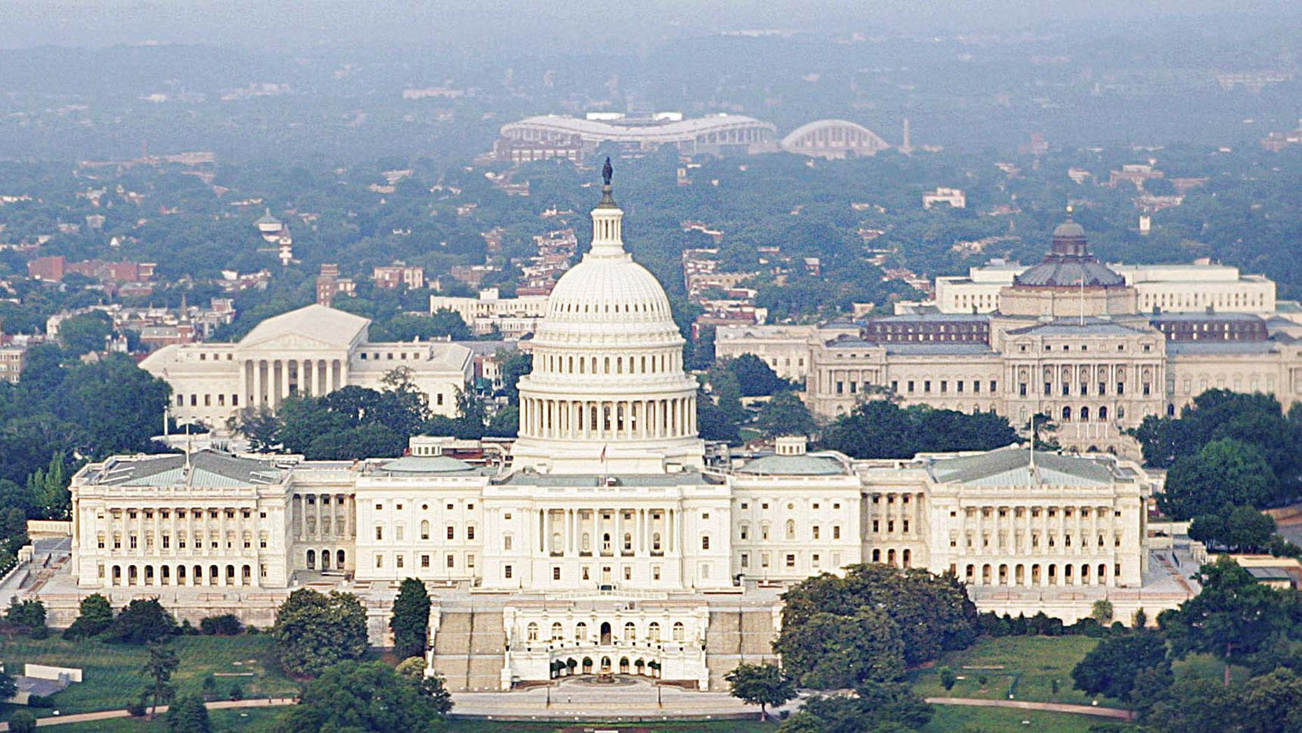 The United States Capitol, center, the Capitol Reflecting Pool, foreground, the U.S. Supreme Court.