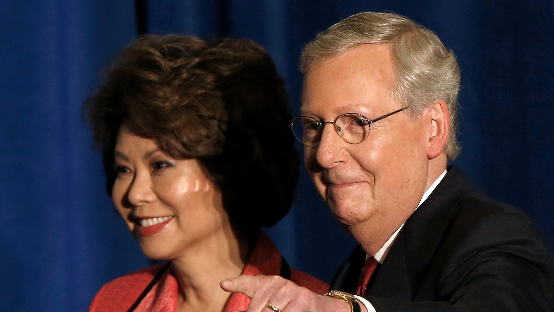 U.S. Senate Republican Leader Sen. Mitch McConnell and his wife Elaine Chao on May 20, 2014 in Louisville, Kentucky.