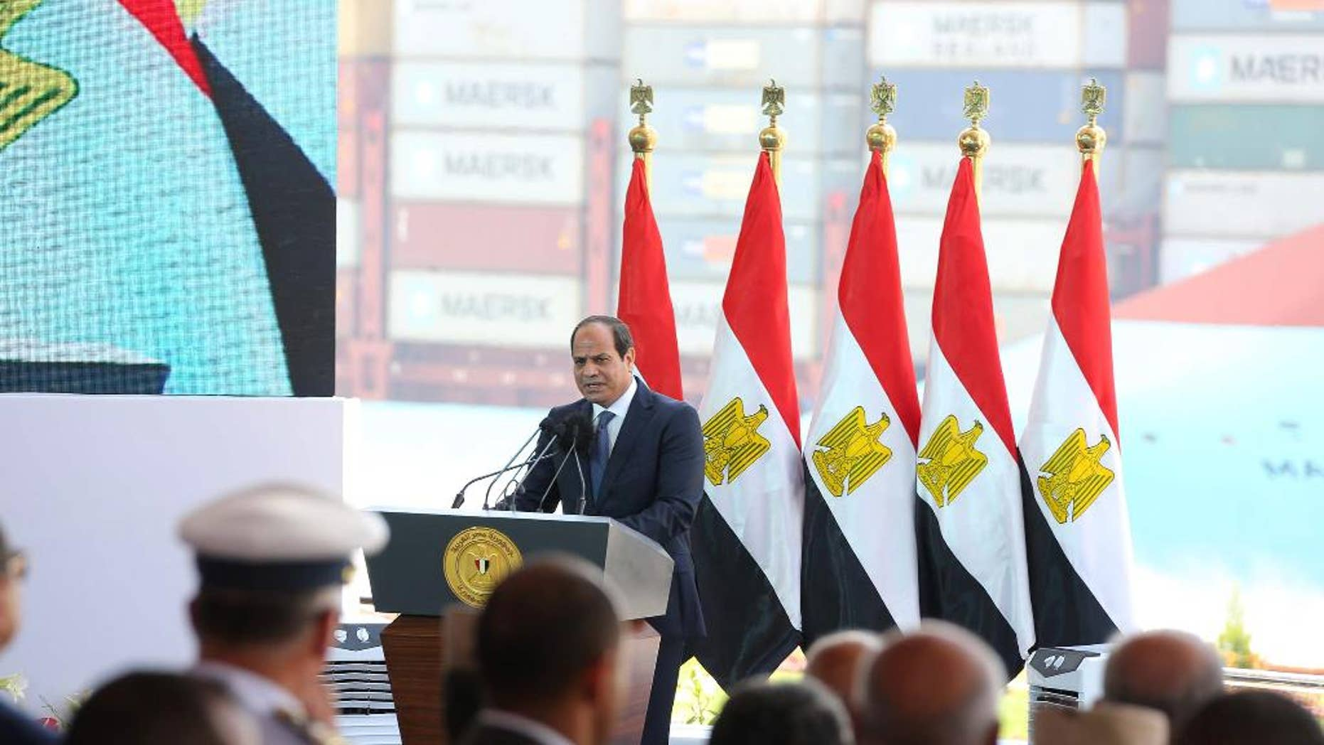 In this photo provided by Egypt's state news agency MENA, Egyptian President Abdel-Fattah el-Sissi, gives a speech marking the first anniversary the first anniversary of the inauguration of an expansion of the Suez Canal, in Suez, Egypt, Saturday, Aug. 6, 2016. Egypt's president has defiantly dismissed criticism of his handling of the country's ailing economy, arguing that the skeptics were seeking to undermine the will of Egyptians. (MENA via AP)