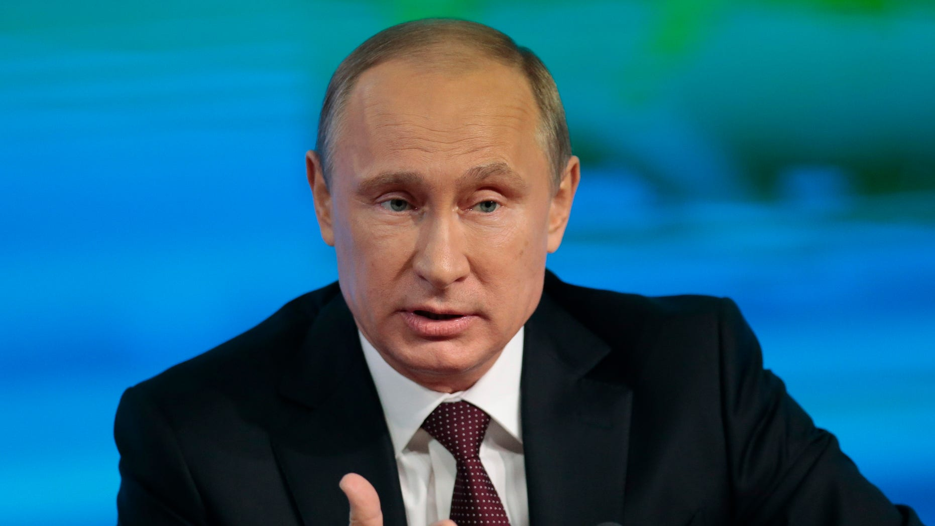 Russian President Vladimir Putin speaks at his annual news conference in Moscow, Russia, Thursday, Dec. 19, 2013. (AP Photo/Ivan Sekretarev)
