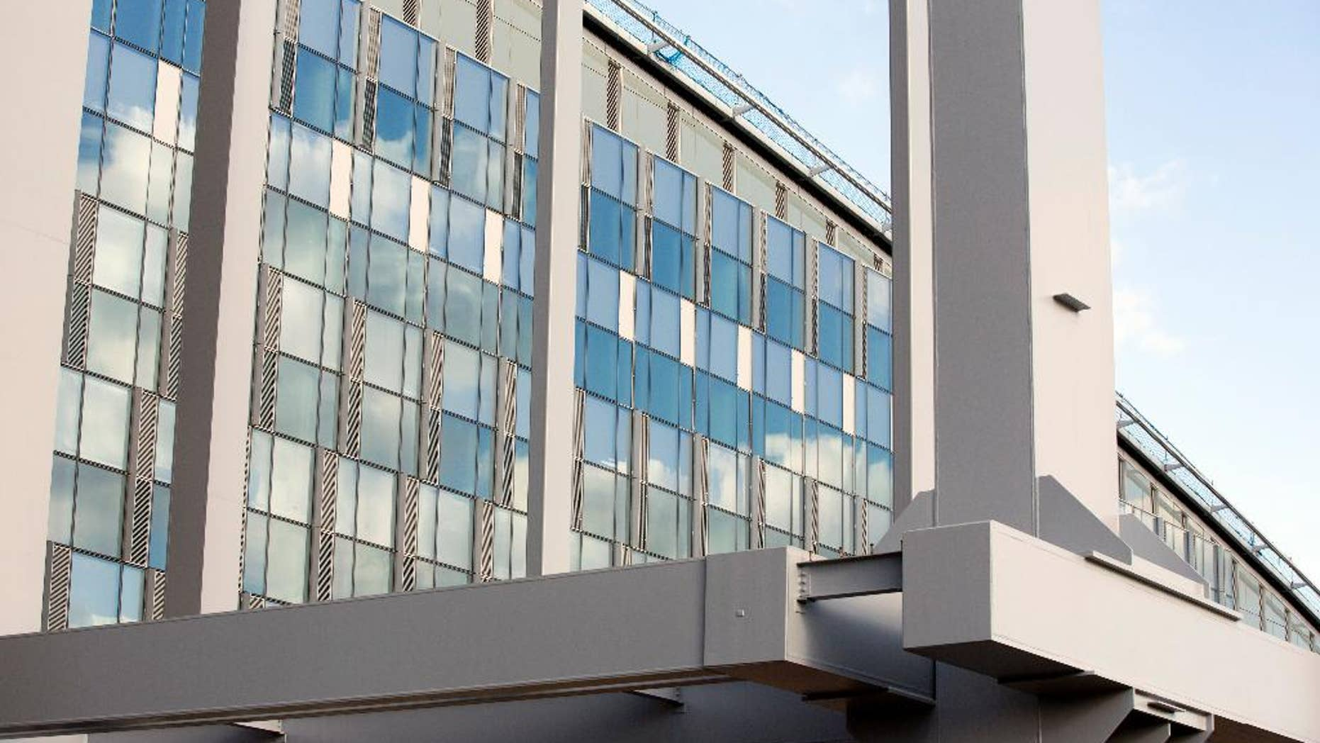 FILE - In this Nov. 13, 2013, file pool photo, steel beams and a glass wall on the exterior of the new NATO headquarters in Brussels. America's substantial support for NATO, both in money and military aid, has long been a source of frustration for U.S. leaders, and questioned by some as a throwback to the Cold War era.(AP Photo/Virginia Mayo, Pool, File)