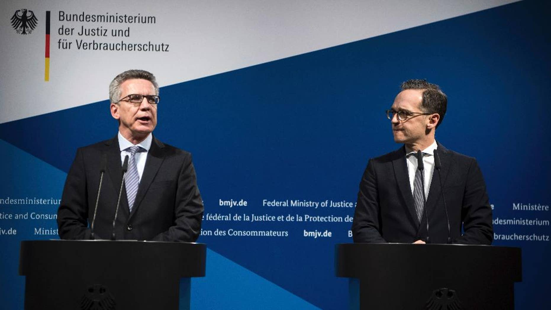 Germany's Interior Minister Thomas de Maizi're, left, and Justice Minister Heiko Maas attend a joint news conference in Berlin, Germany, Tuesday, Jan. 10, 2017. Germany's interior and justice ministers agreed Tuesday to toughen the rules on deporting failed asylum-seekers and monitoring extremists in response to last month's deadly truck attack on a Christmas market. (Bernd von Jutrczenka/dpa via AP)